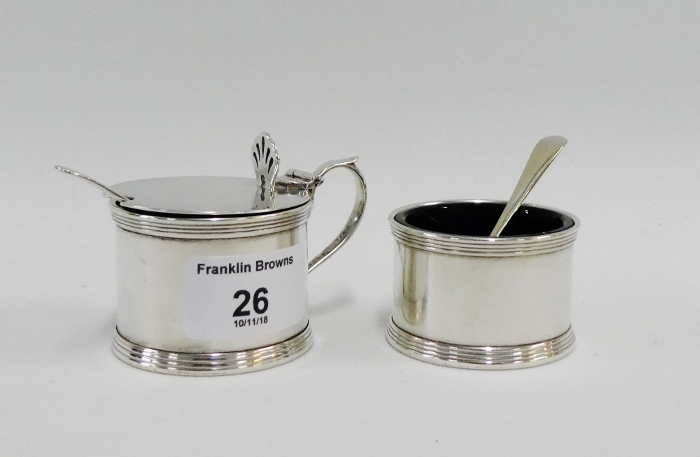Lot 26 - George V silver salt and mustard pots of circular form with blue glass liners and one original