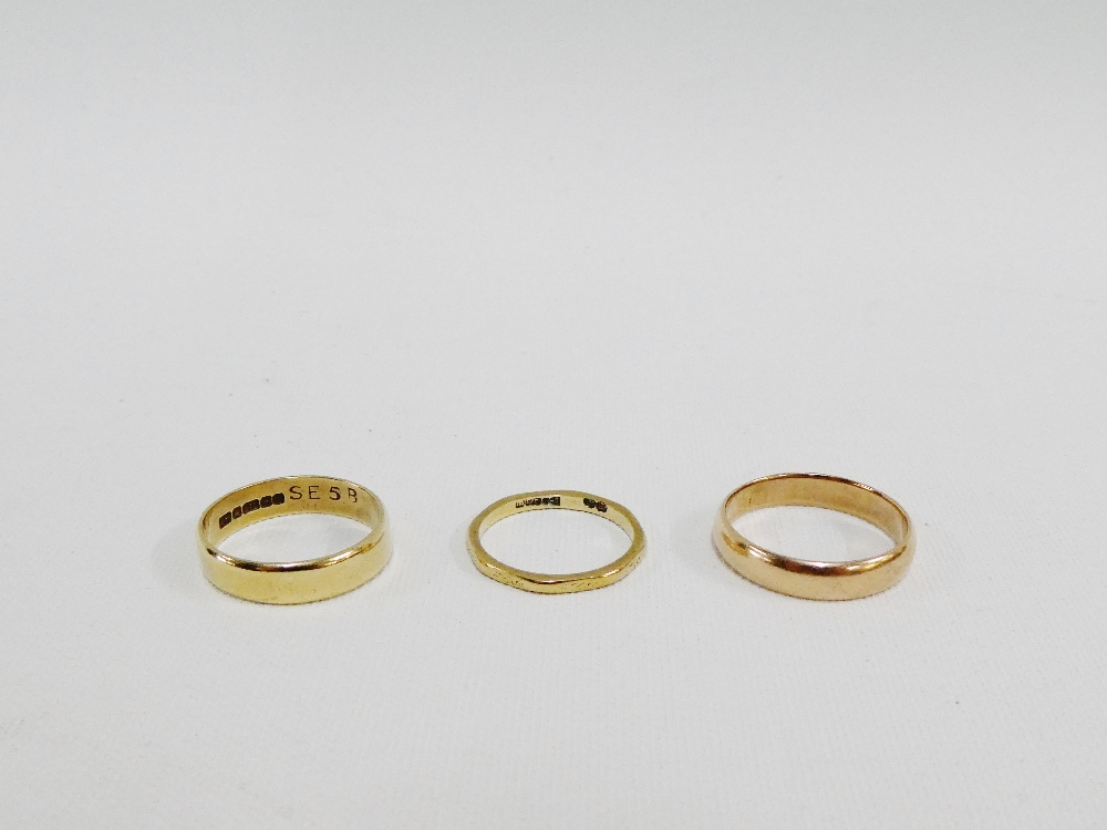 Lot 39 - Three 9 carat gold wedding bands (3)