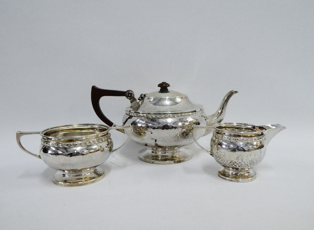 Lot 53 - George V silver three piece teaset with hammered finish by Albert Edward Jones, Birmingham 1924 (3)