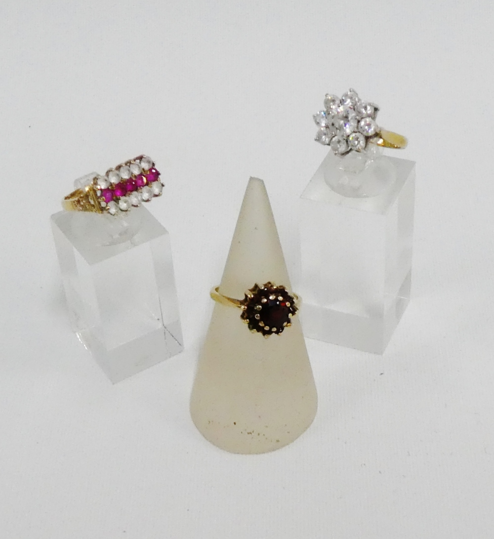 Lot 59 - 9 carat gold garnet set dress ring together with a two 9 carat gold paste set dress rings (3)