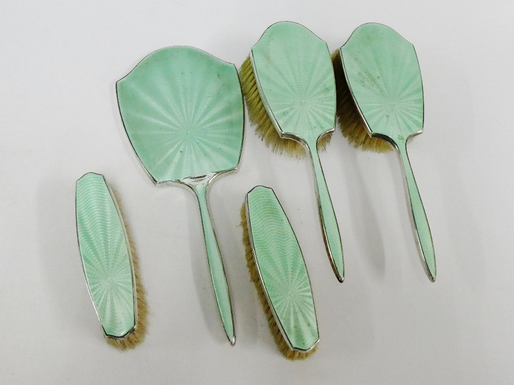 Lot 33 - Birmingham silver and guilloche enamel dressing table brush set comprising mirror, two clothes