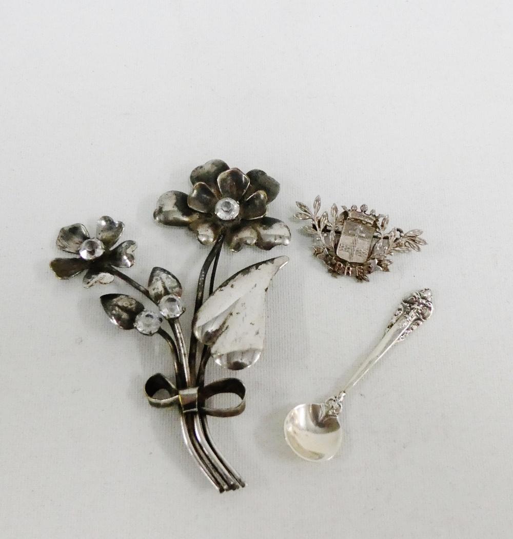 Lot 45 - Ypres white metal brooch, paste set floral brooch and a Sterling silver salt spoon (3)