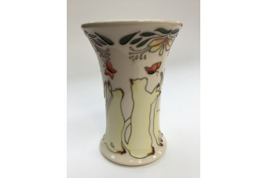 A Moorcroft Lucky Vase In A Different Colourway Designed By Paul