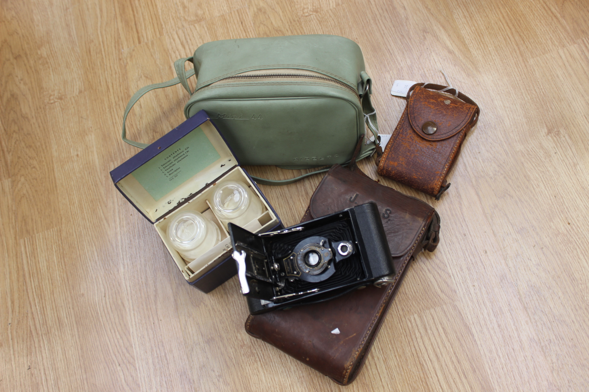 a kodak vest pocket camera with tan leather case dated 1916 1930s