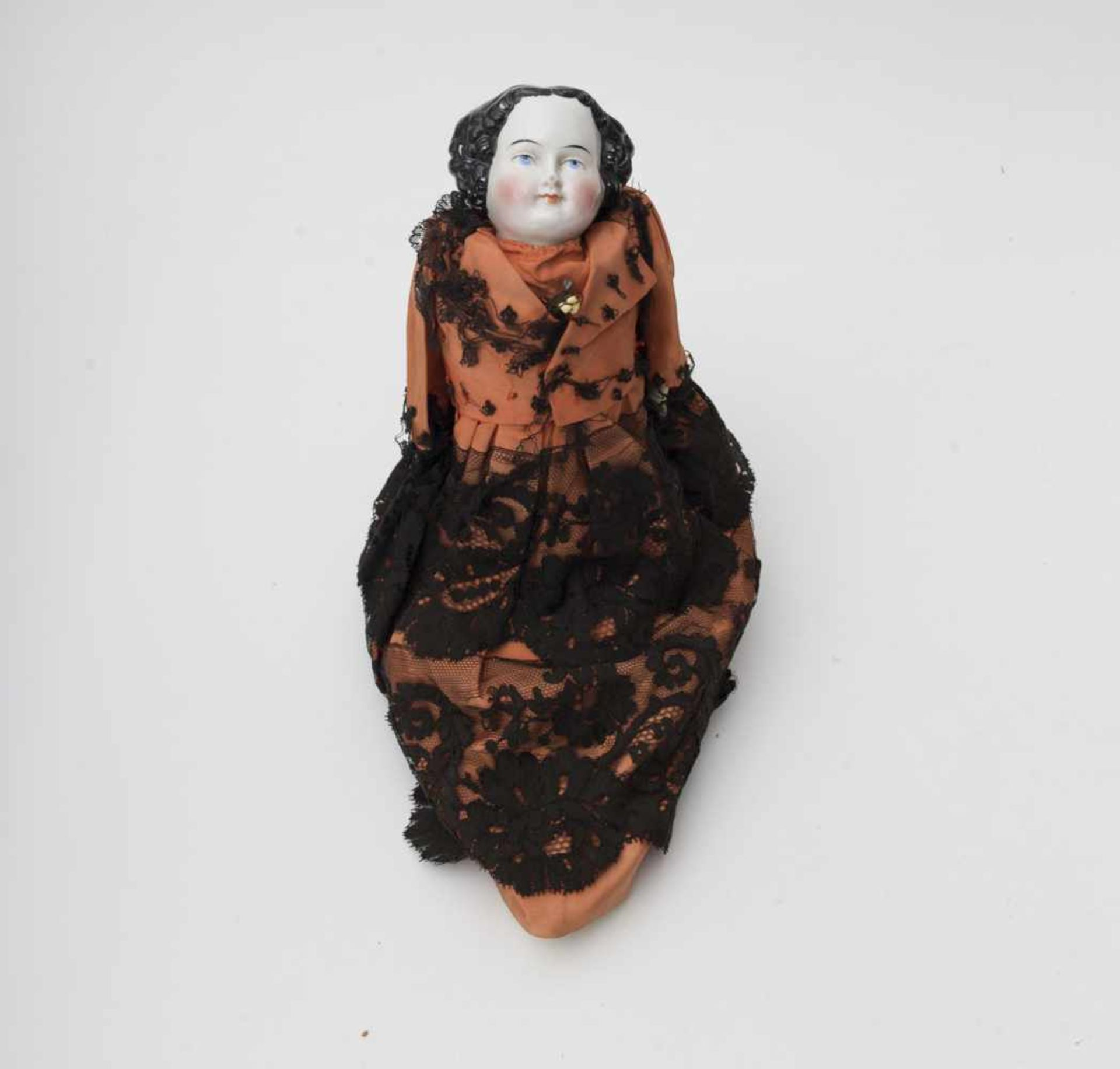 German doll With porcelain head, painted blue eyes, 19th century-style moulded hair, kidskin body