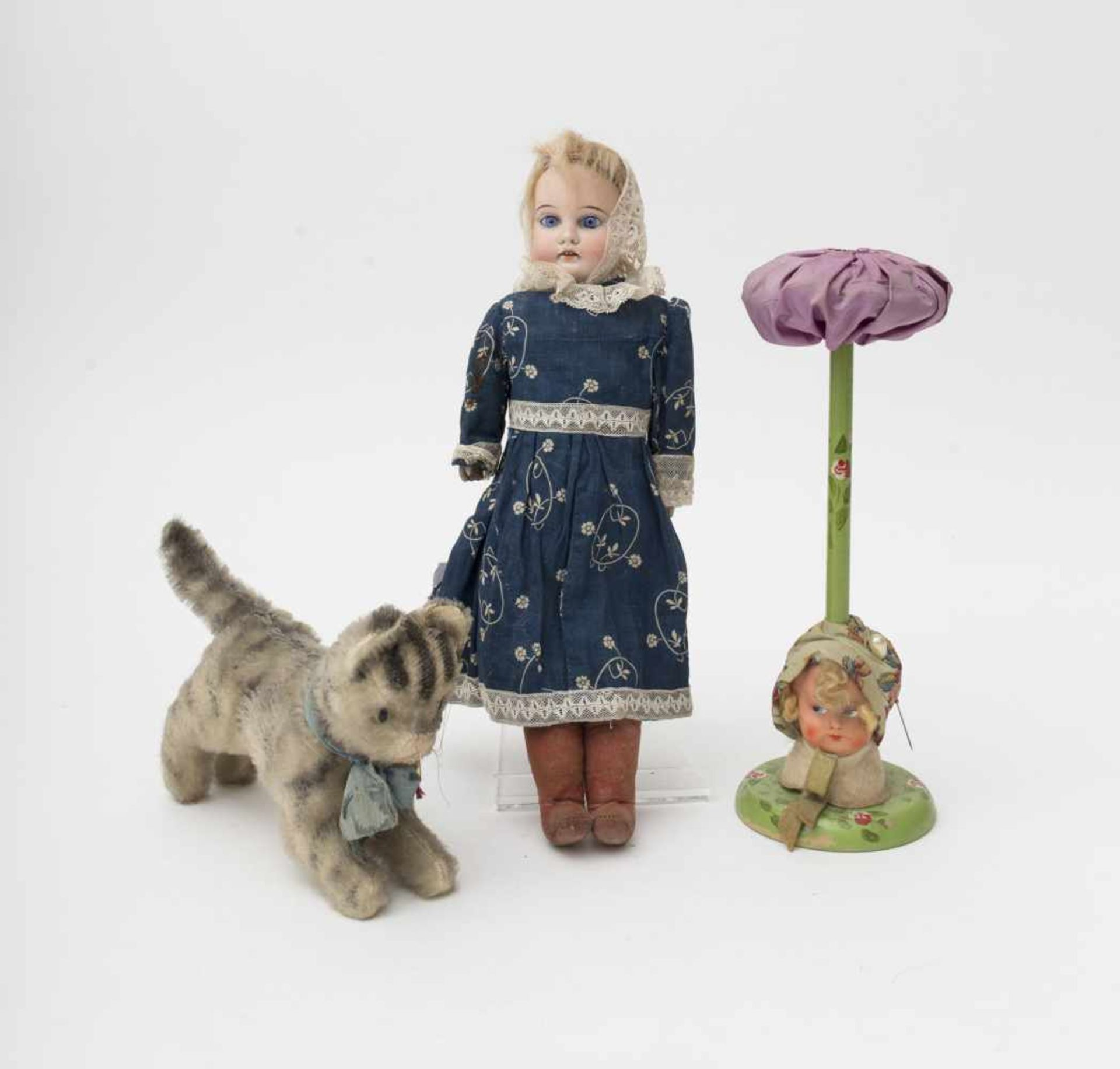 German doll With biscuit head, open mouth, fixed blue eyes, kidskin body. Included is a little