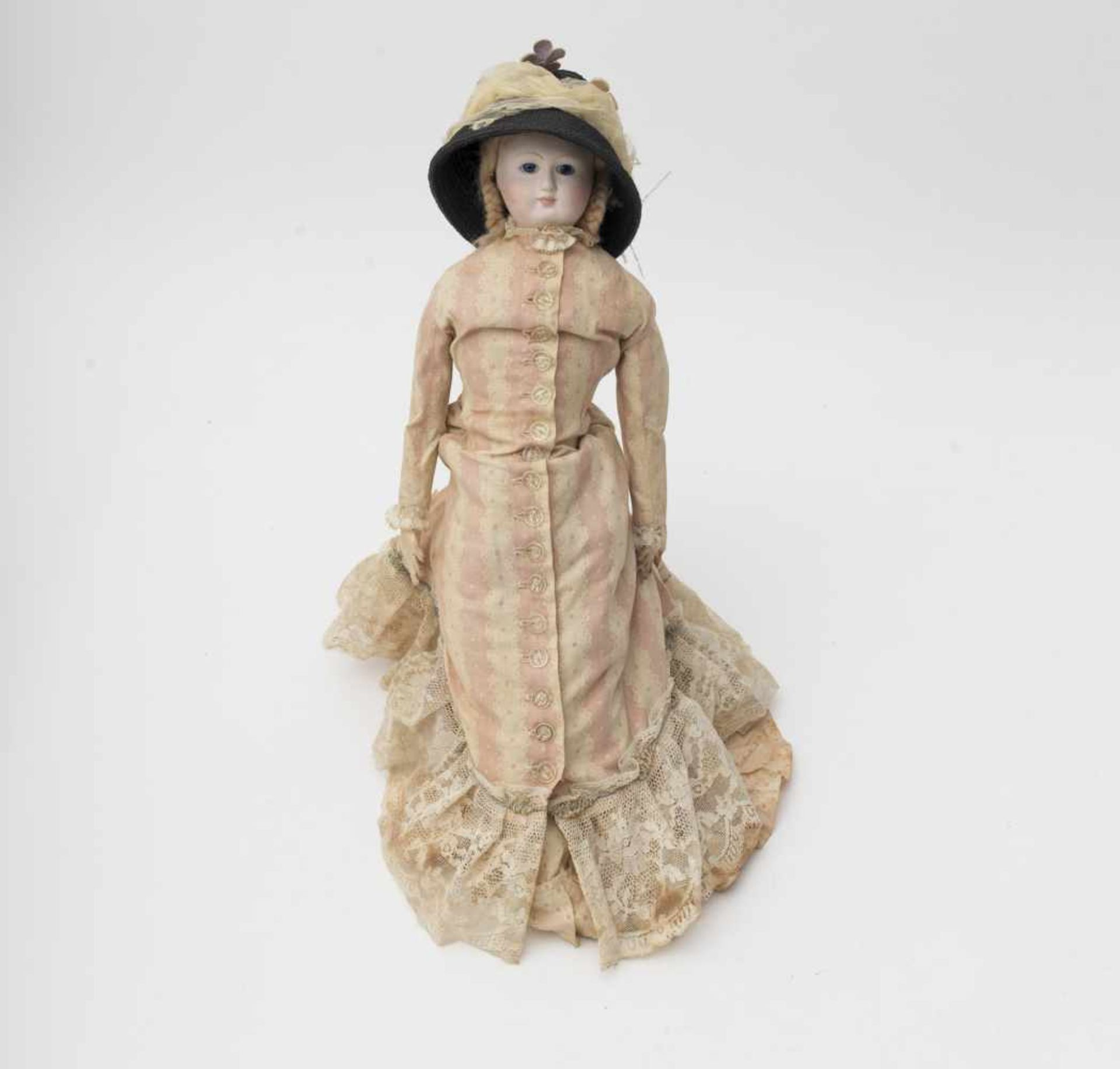 Fashion doll Parisian-type in the old style, with biscuit head and torso, kidskin body, H=45cm.