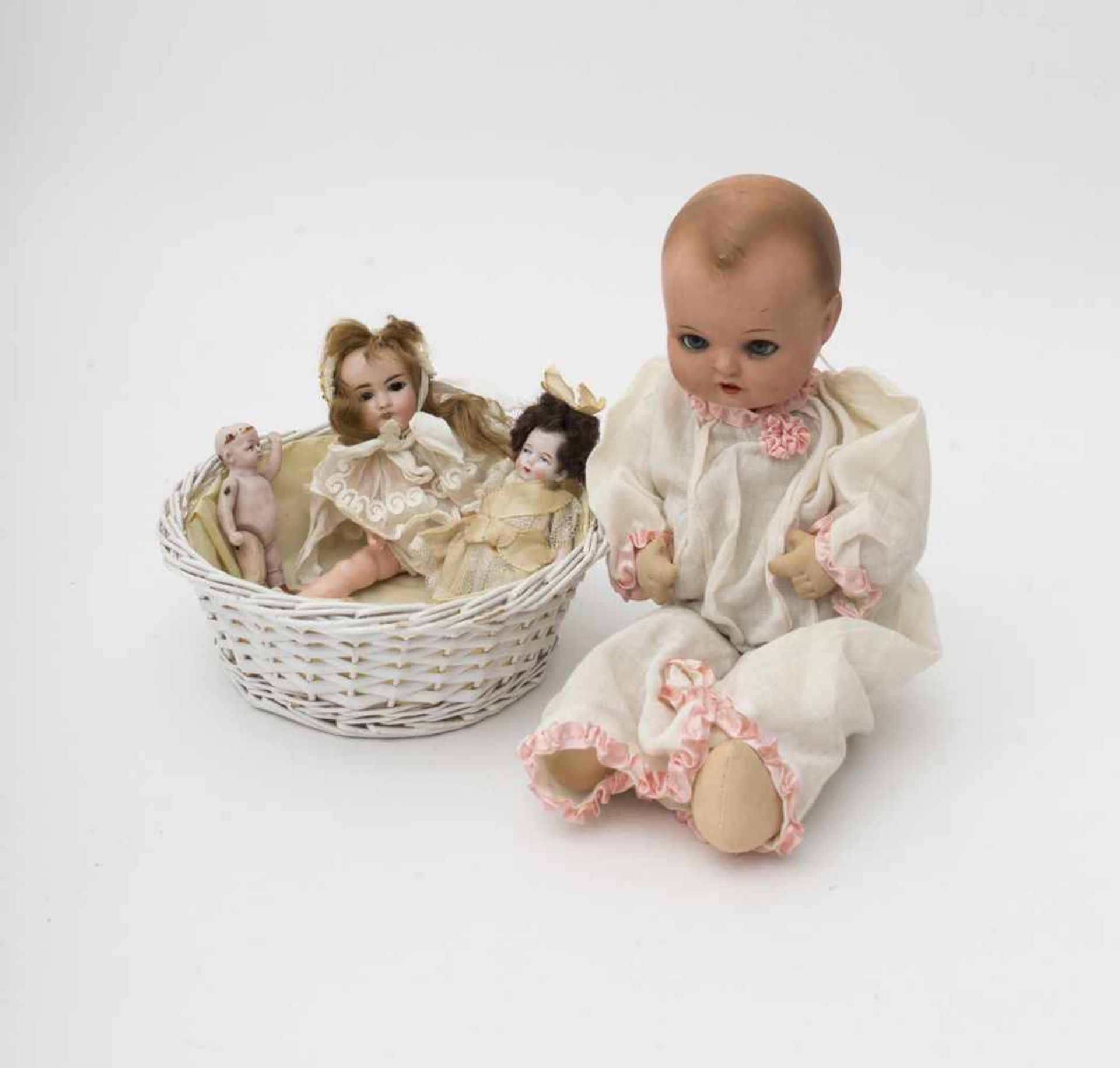 Basket Includes small baby doll with composition head –4 dolls in total, with biscuit head and