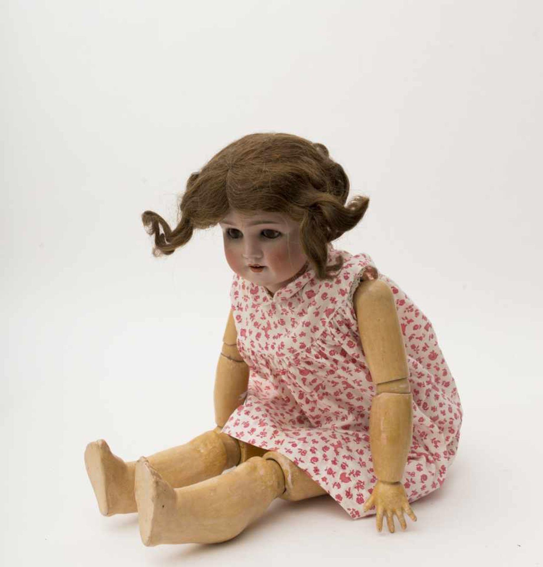 """German doll With biscuit head, open mouth, branded """"SCHOENAU & HOFFMEISTER"""", brown sleeping eyes,"""