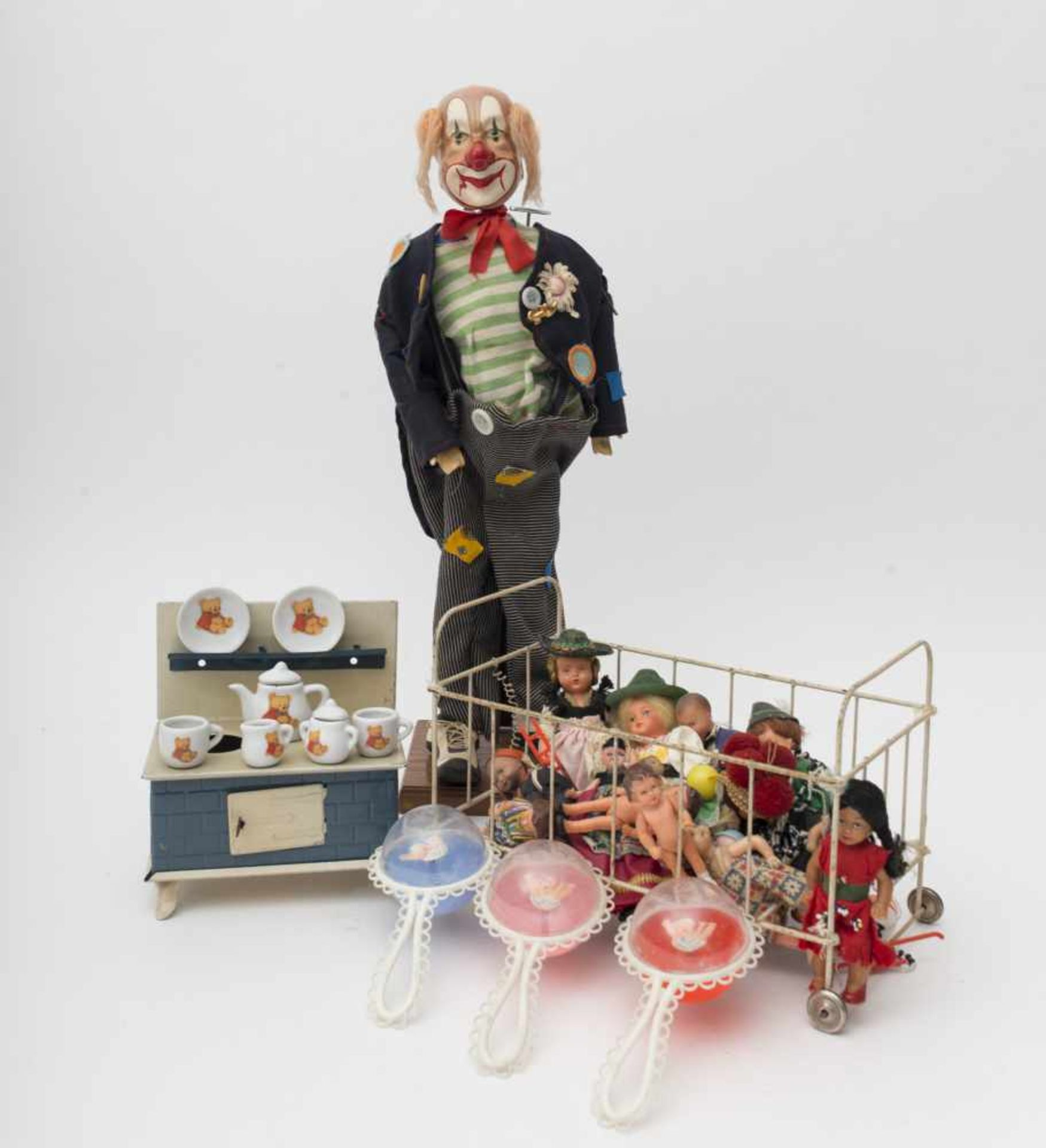 Set of various accessories Including a small sheet metal cooking range – metal bed – folkloric dolls