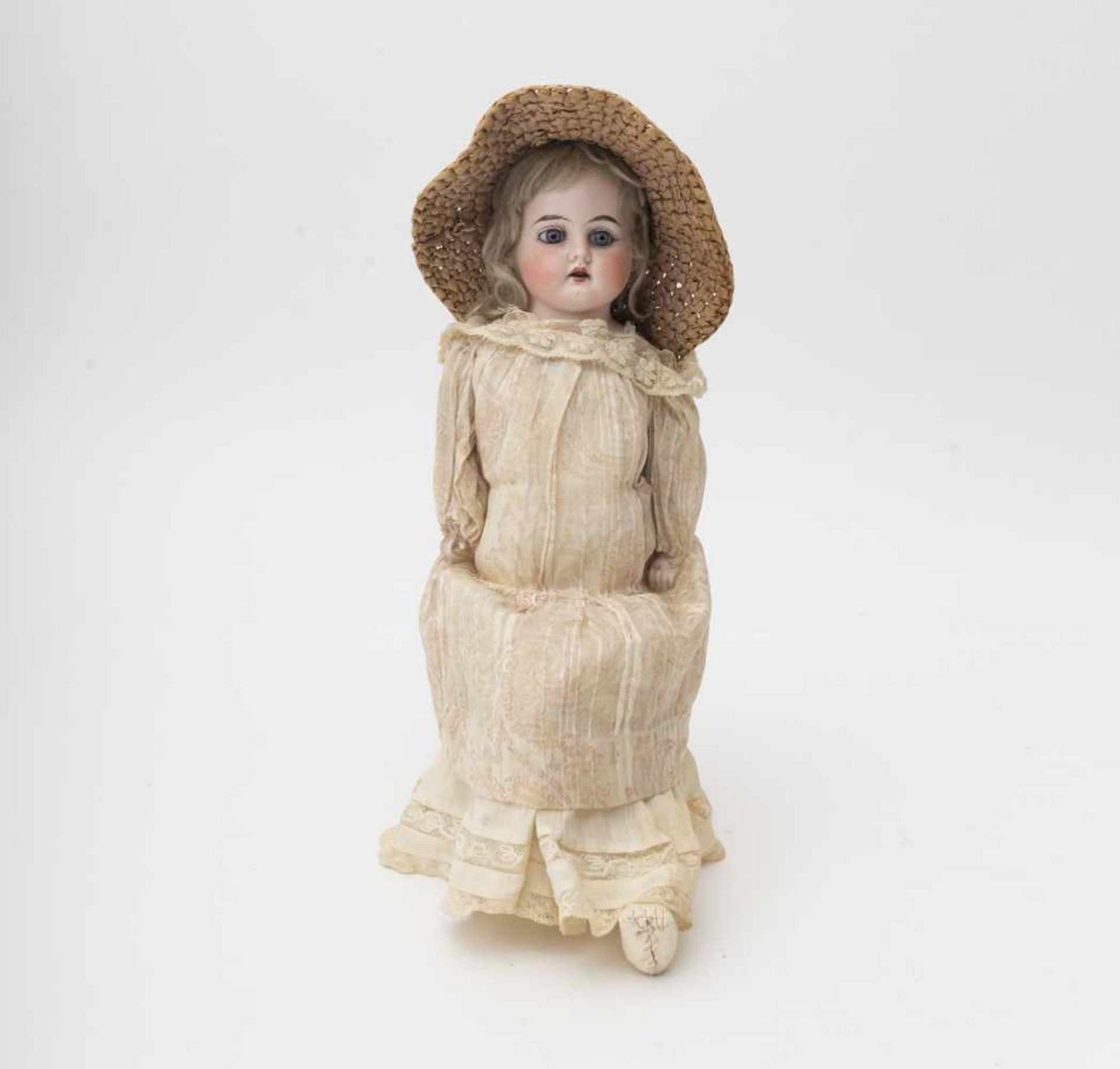 German doll Biscuit head and torso, open mouth, branded with a horseshoe, fixed blue eyes,