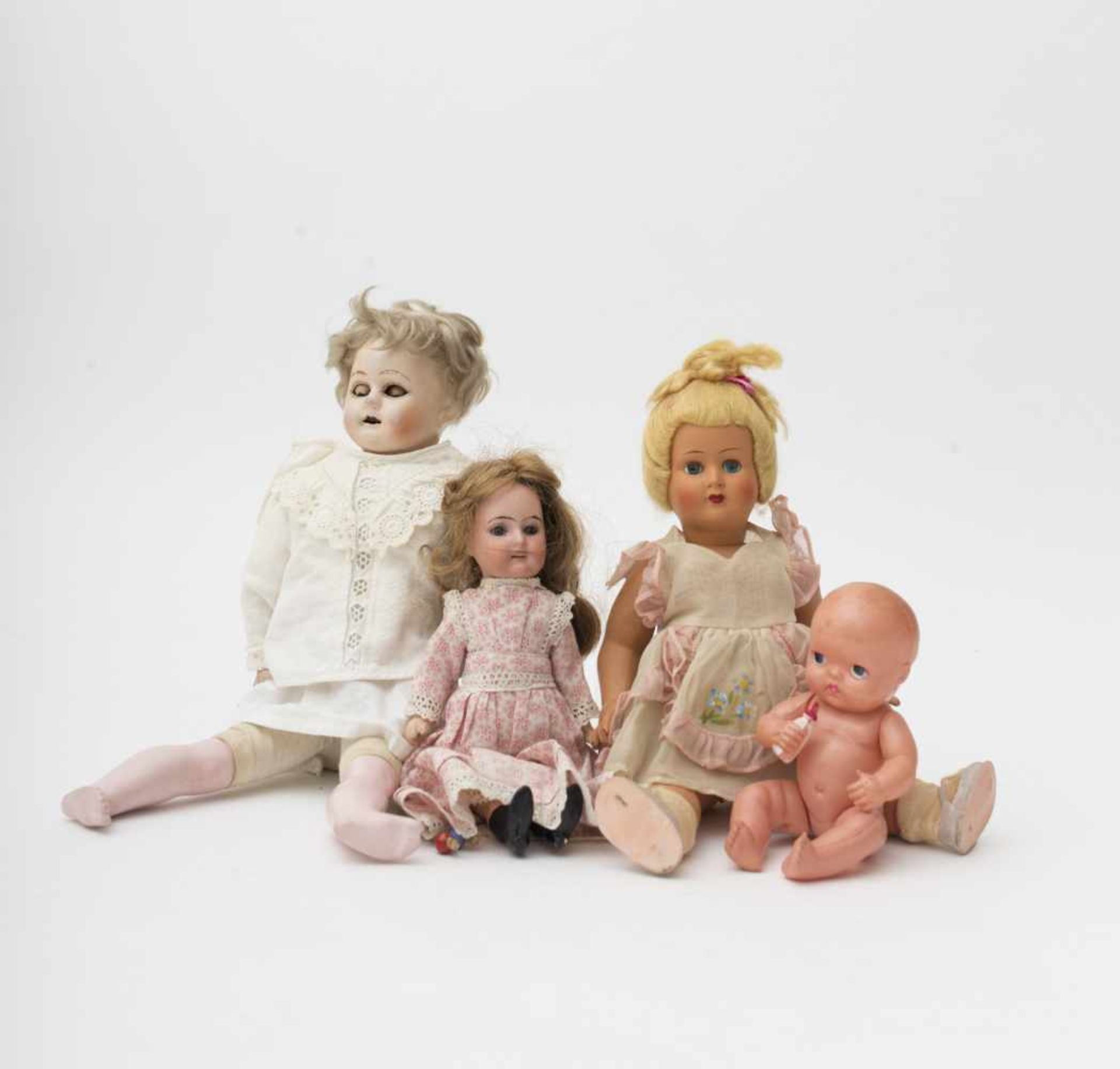 Set of 4 dolls One 1940 carnival doll – talking doll with damaged wax head and torso –celluloid baby