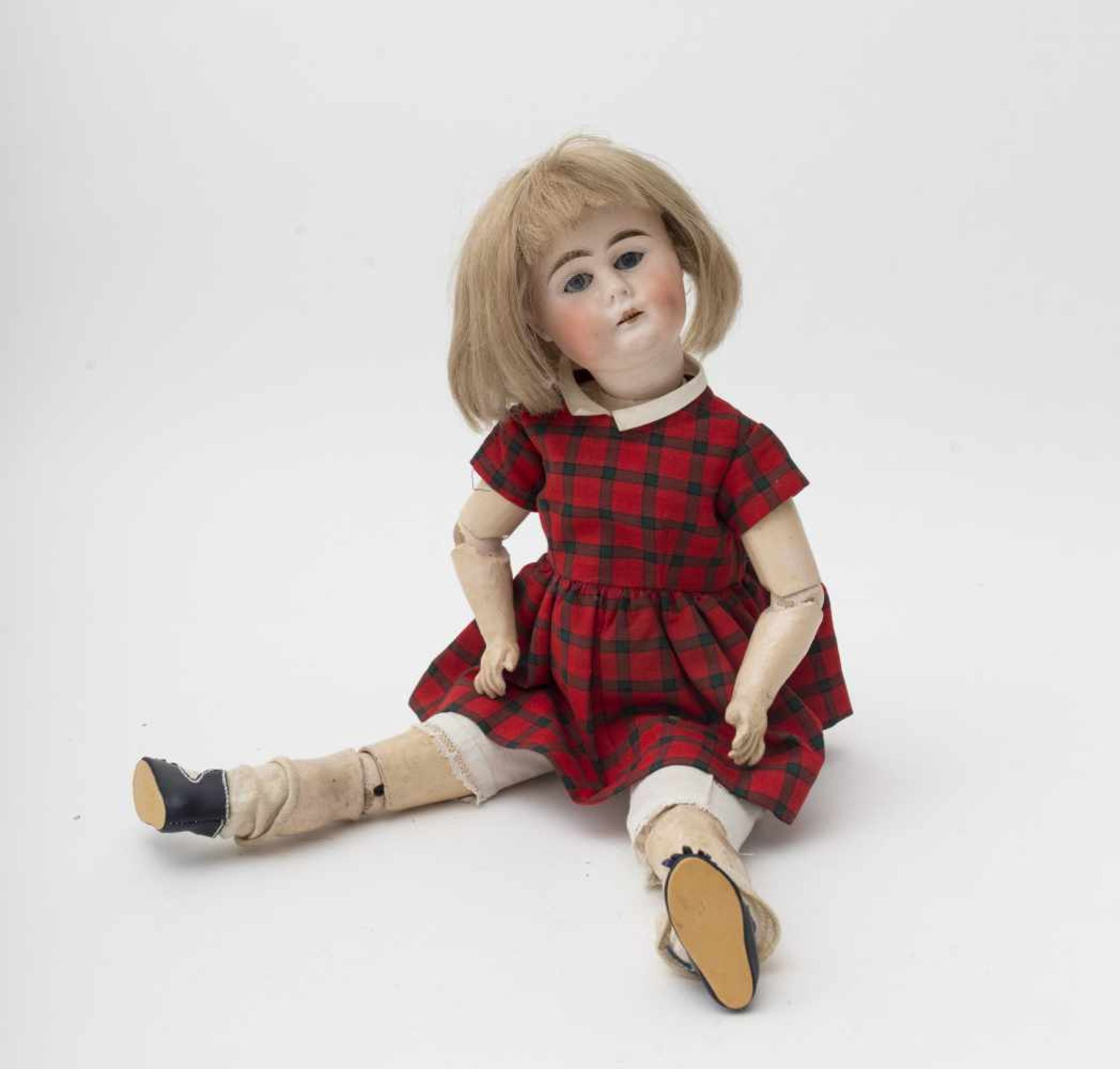 German doll With biscuit head, open mouth, fixed blue eyes, original articulated body, H=51cm.