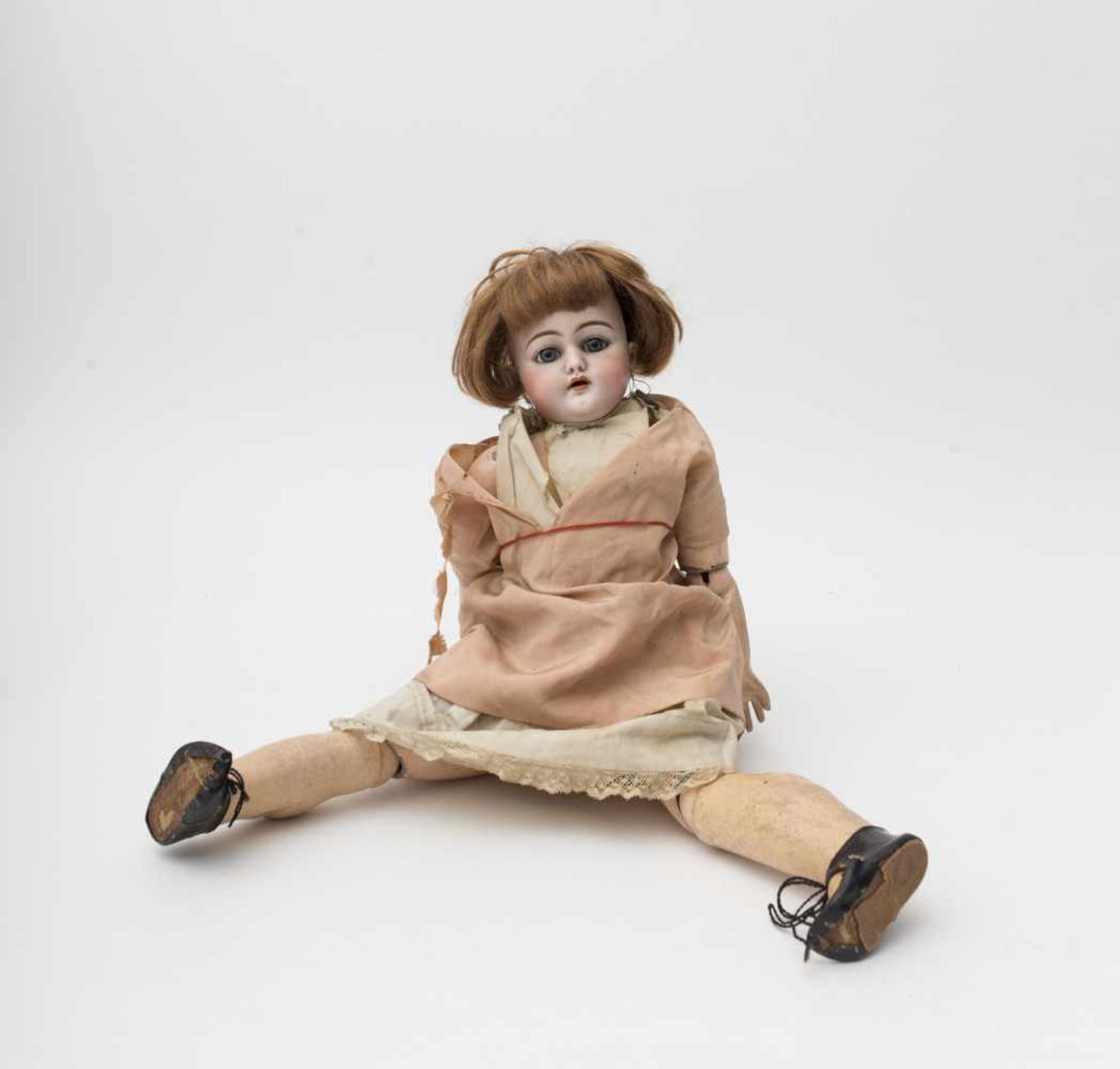 "German doll With biscuit head, open mouth, marked ""S & C 7 ½"", blue sleeping eyes, articulated body,"