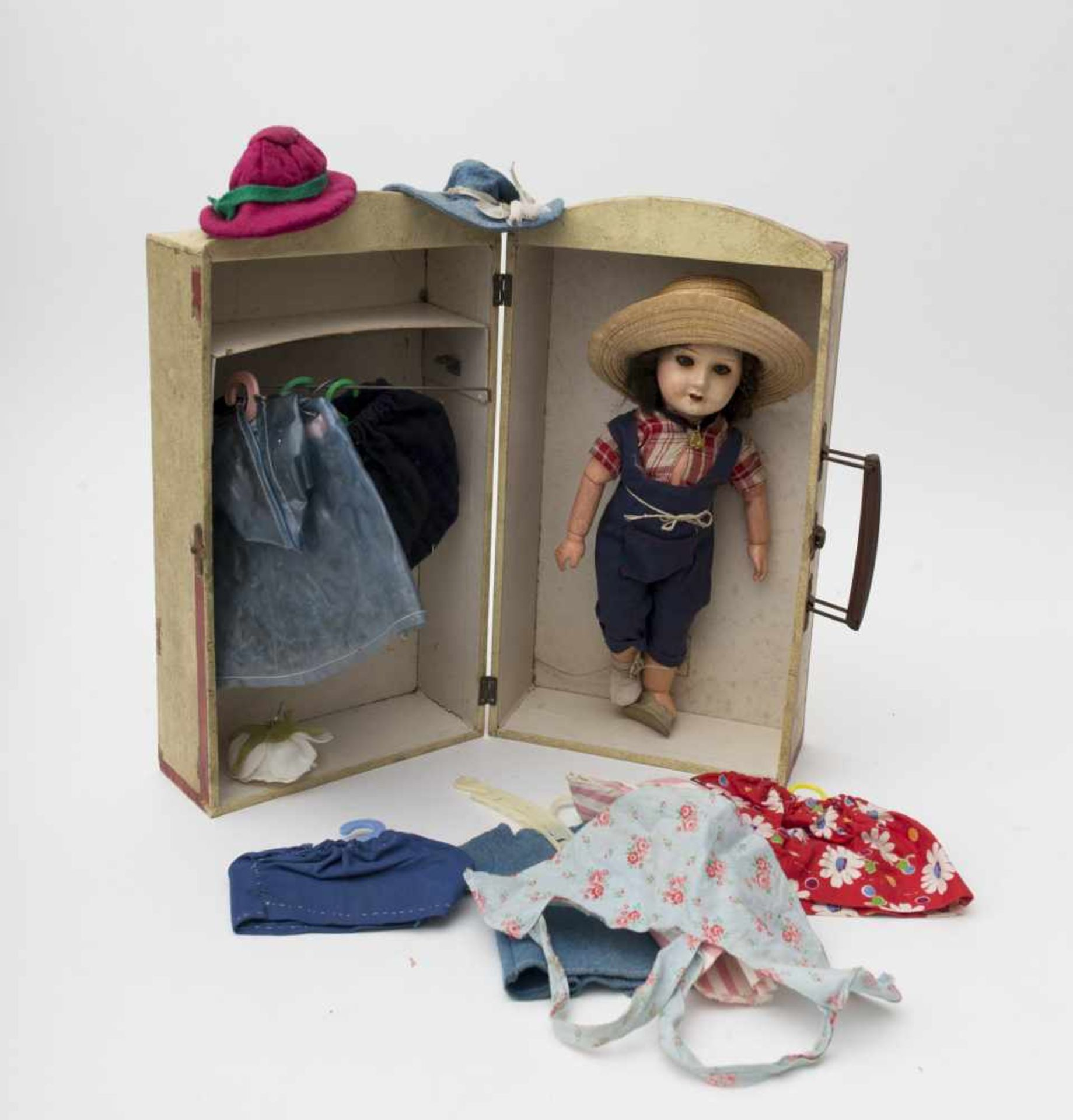 Wardrobe Comprised of a doll with composition head, size 4, articulated body – dresses and coats.
