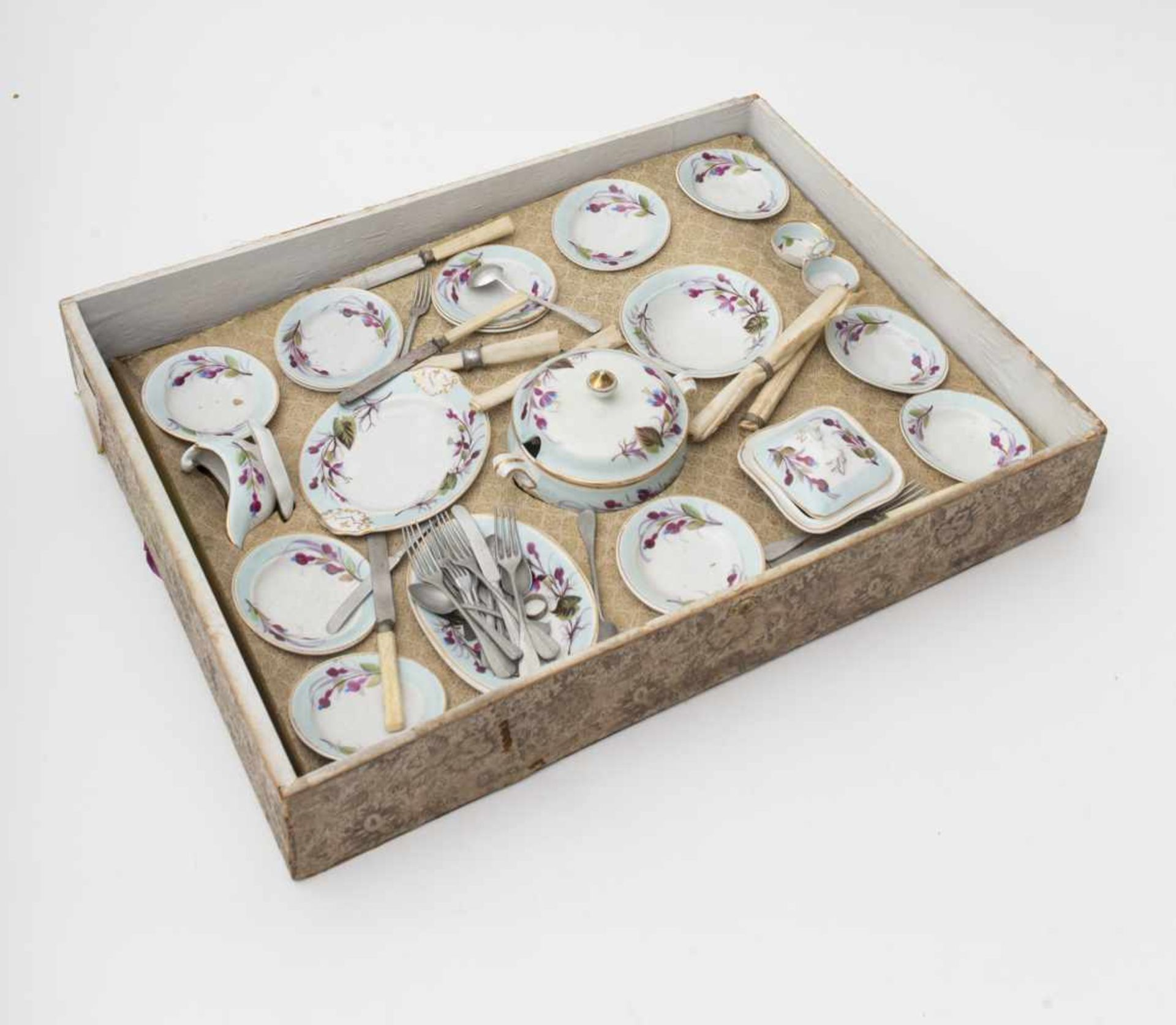 Child's table setting In its case, set comprised of a soup tureen – platter – dishes – salt cellar