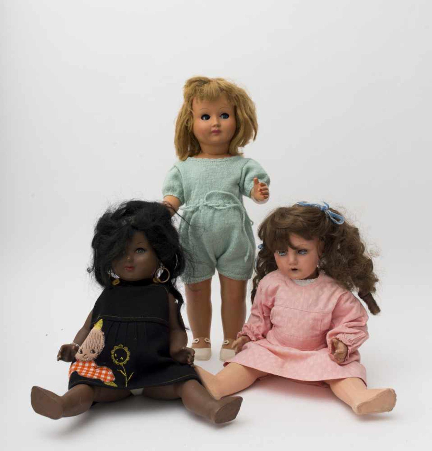 Three composition dolls ATHENA PIACENZA 50 and UNICA Belgium, H=40 to 52cm.