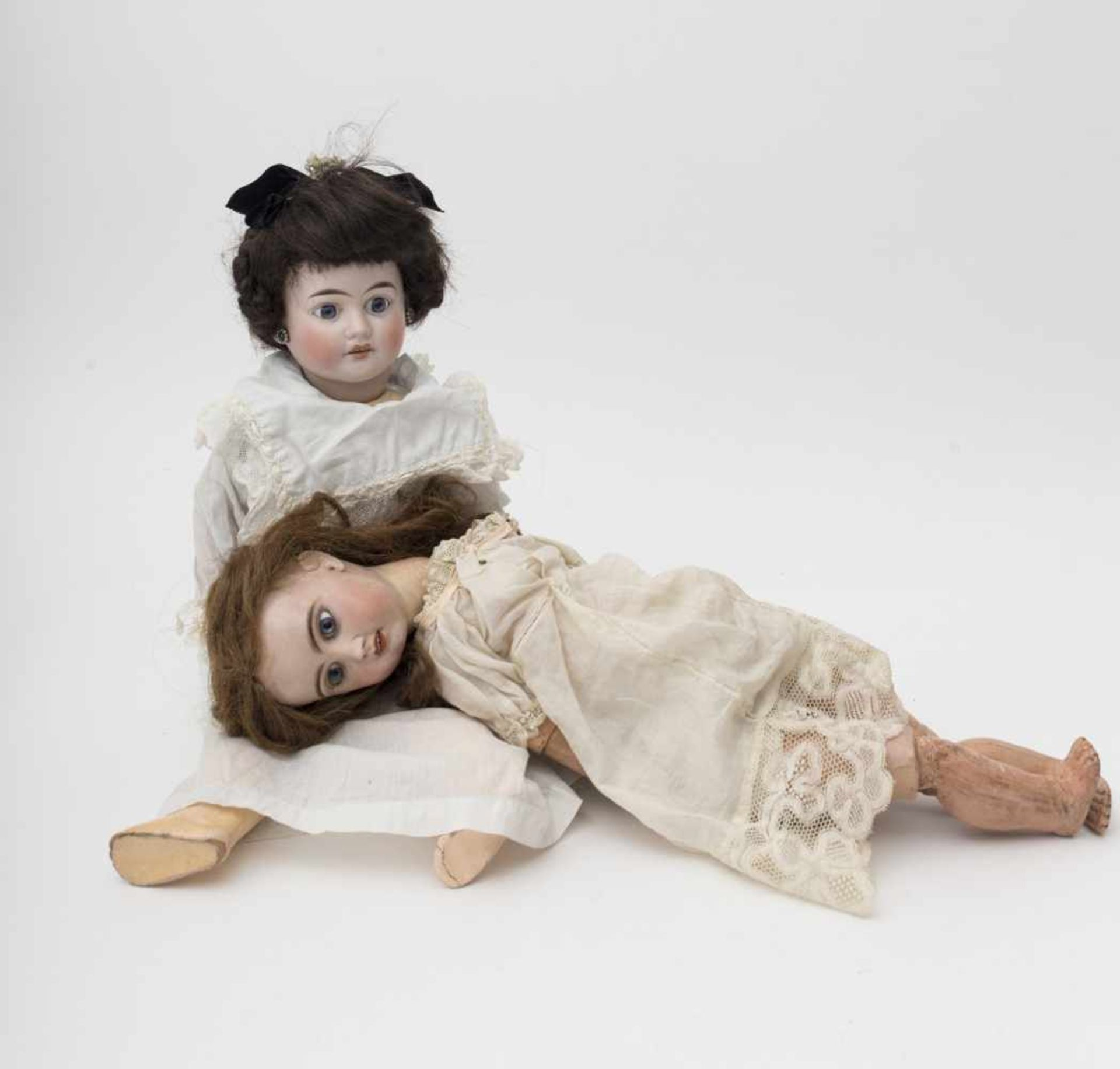 """Two dolls One with a biscuit head, branded """"JUMEAU"""", fixed blue eyes, restored neck, UNIS France"""
