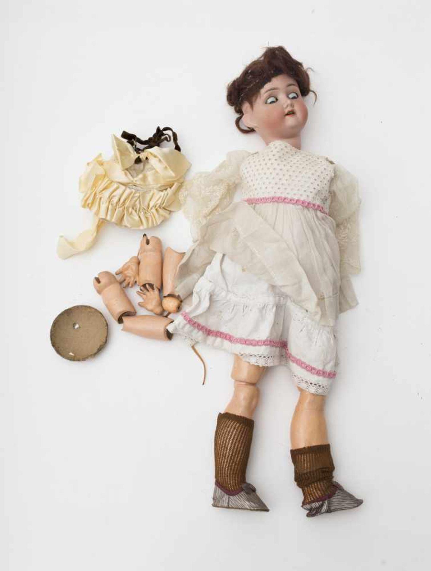 """German doll With biscuit head, open mouth, branded """"SCHOENAU & HOFFMEISTER"""", blue sleeping eyes,"""