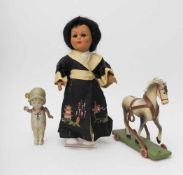 RATTI Japanese doll Of Italian make, ref. 3270/37 (bo). Papier-mâché horse on rolling stand, L=20cm,