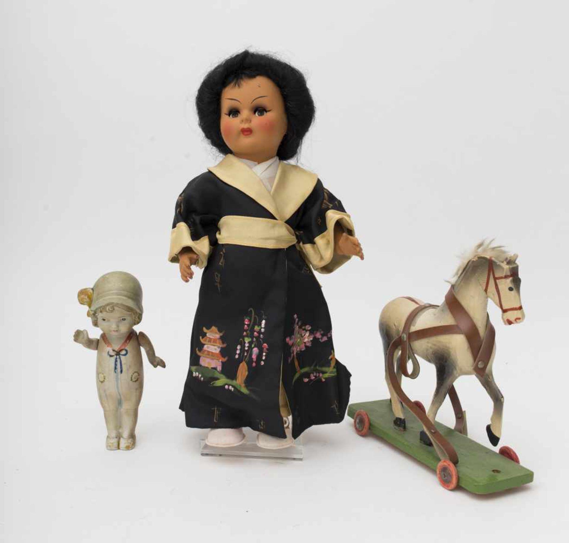 RATTI Japanese doll Of Italian make, ref. 3270/37 (bo). Papier-mâché horse on rolling stand, L=20cm,
