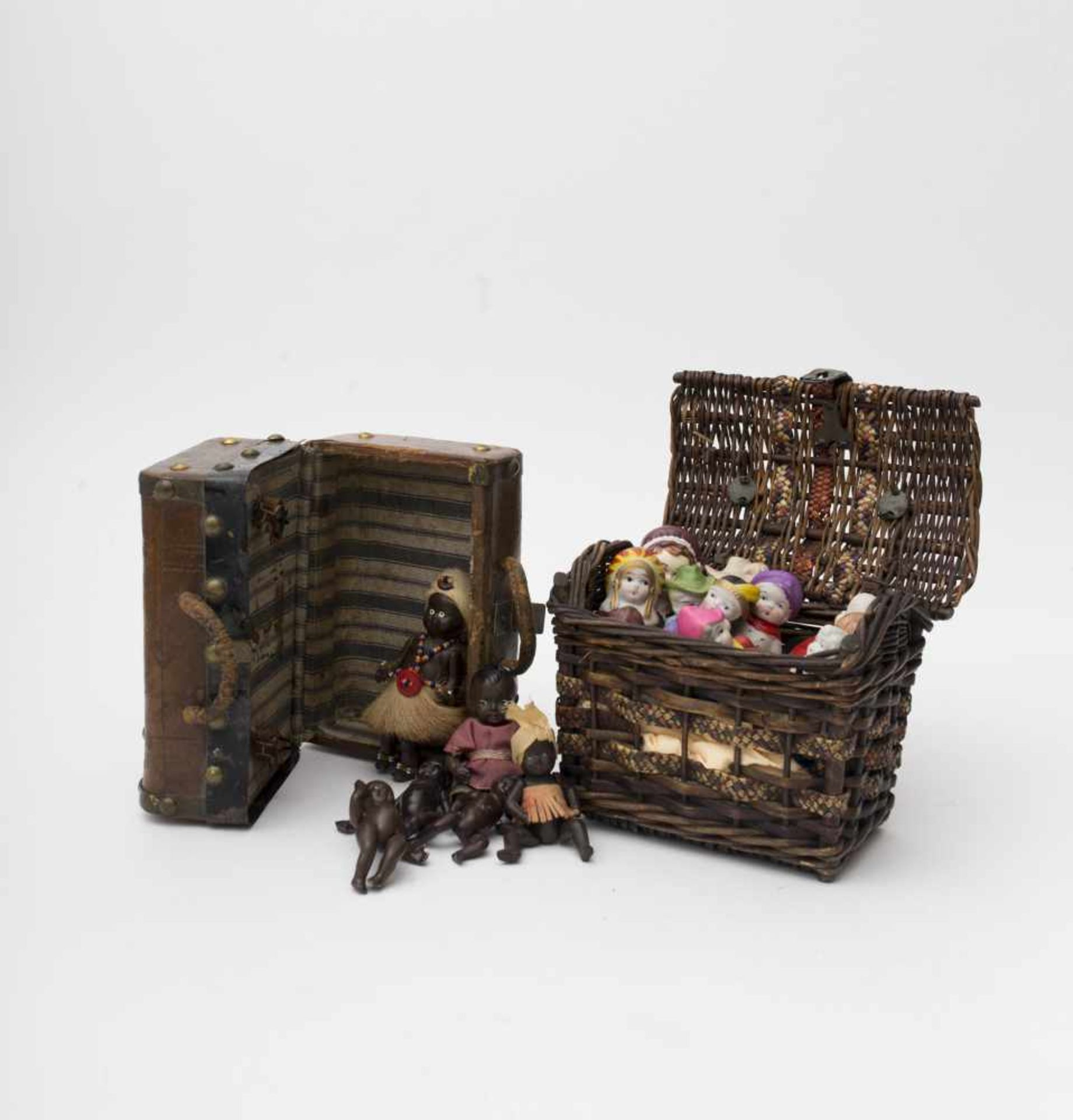 Wicker basket Containing decorative biscuit and cartoon figures (12 pieces.), and a small travel