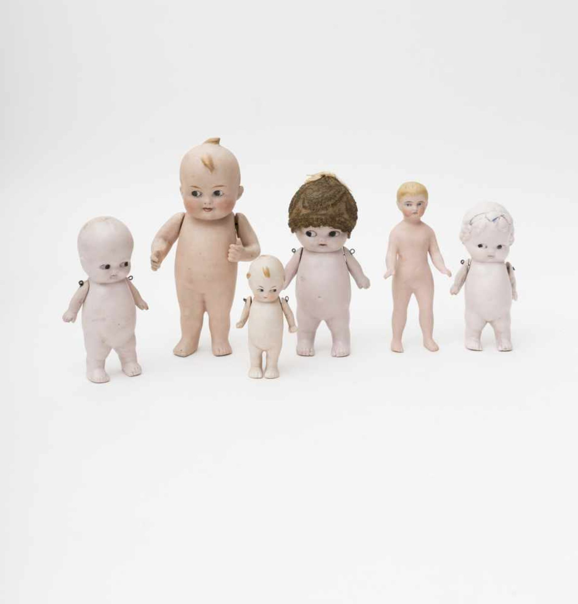 Six biscuit baby dolls KEEPIE and bath type, German make, ranging from 9 to 18cm.
