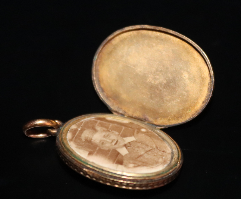 Lot 175 - Victorian Gold Enamelled Locket, The Front With Applied Star Burst