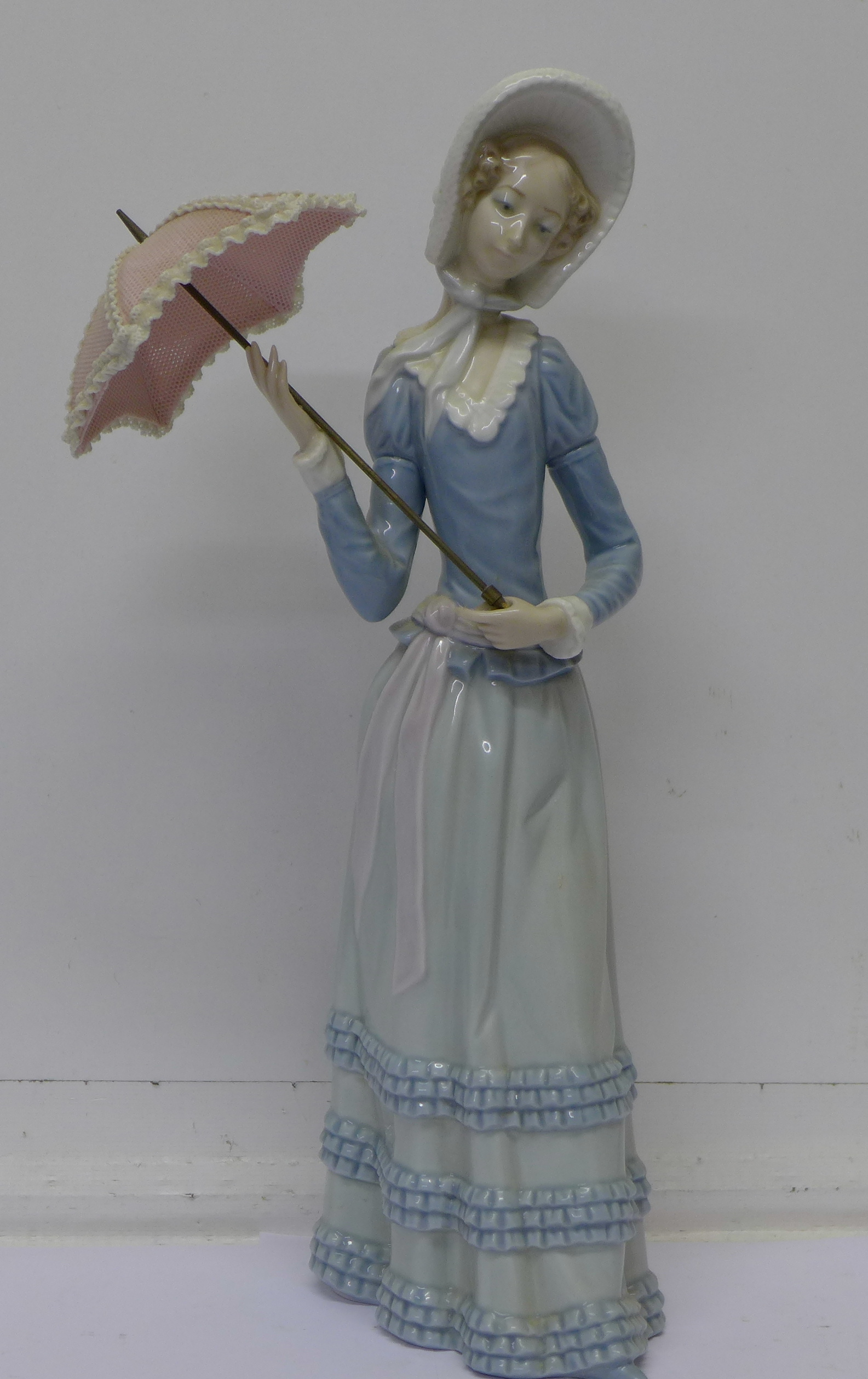 A Lladro Figure H212 Standing Lady With Parasol 32cm