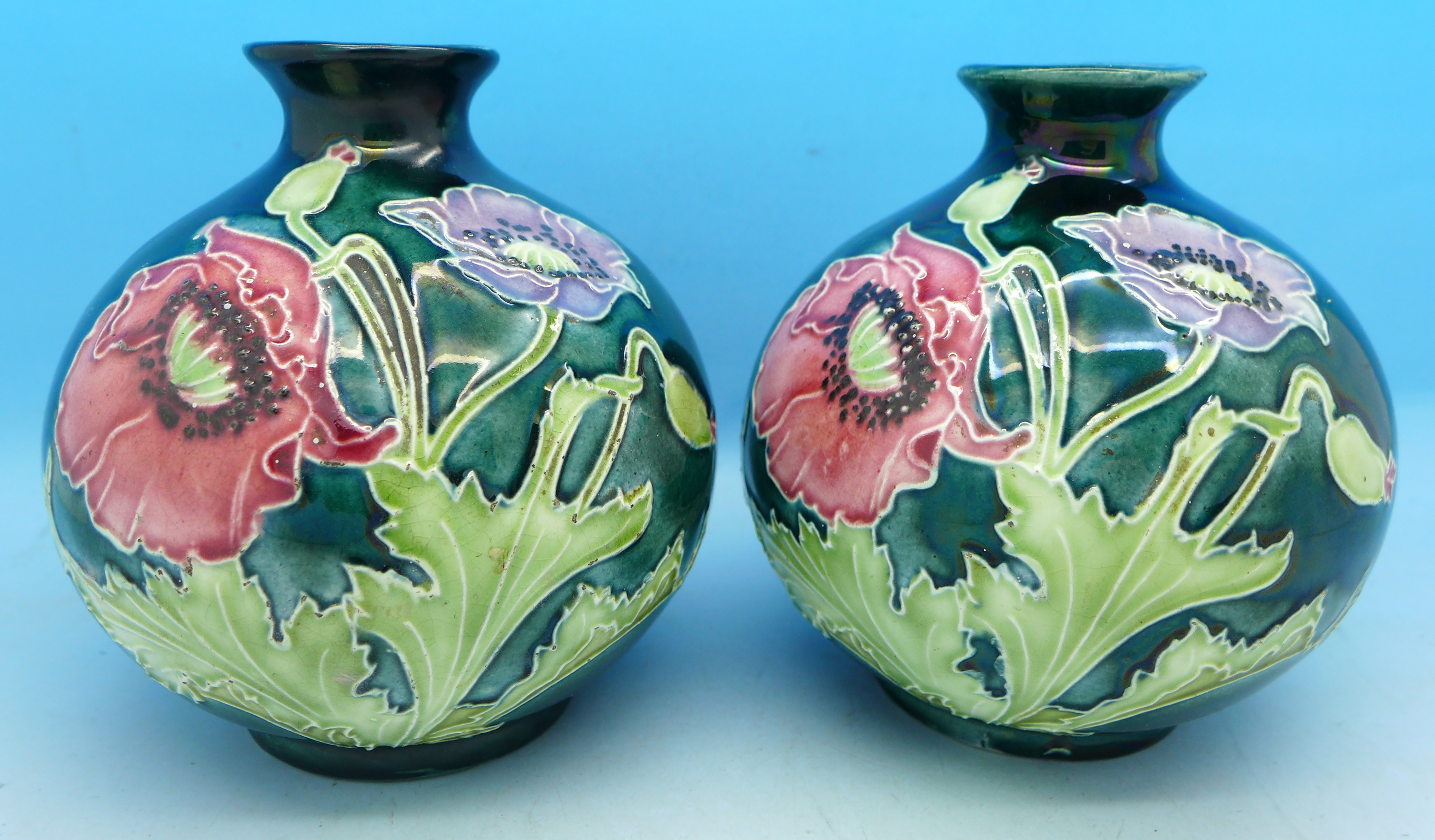 Lot 621  A Pair Of Globular Vases Decorated With