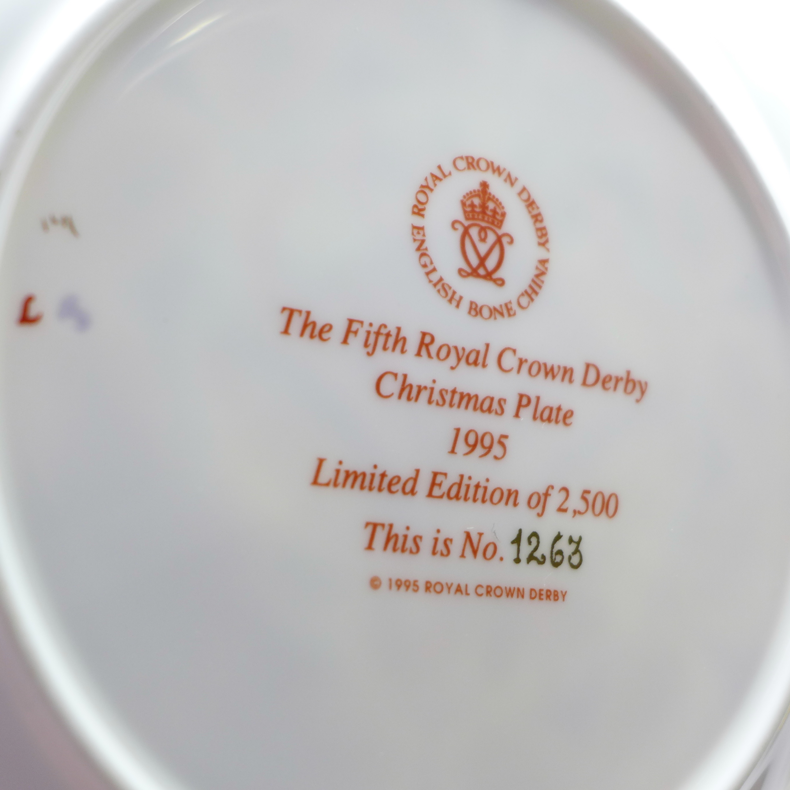 Lot 617 - Two Royal Crown Derby limited edition Christmas plates, The Fifth Christmas plate 1995,