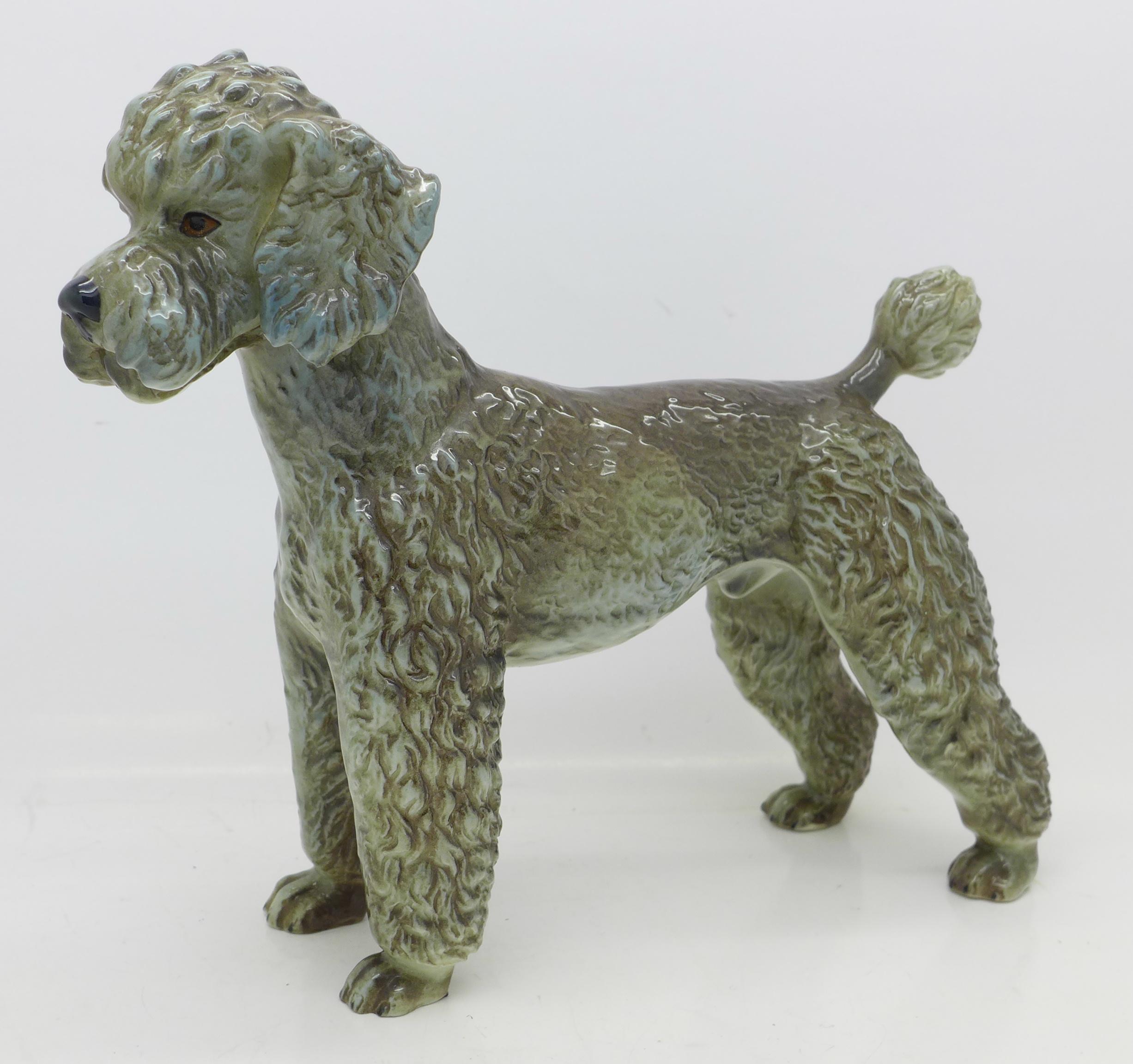 Lot 631 - A Goebel figure of a poodle,