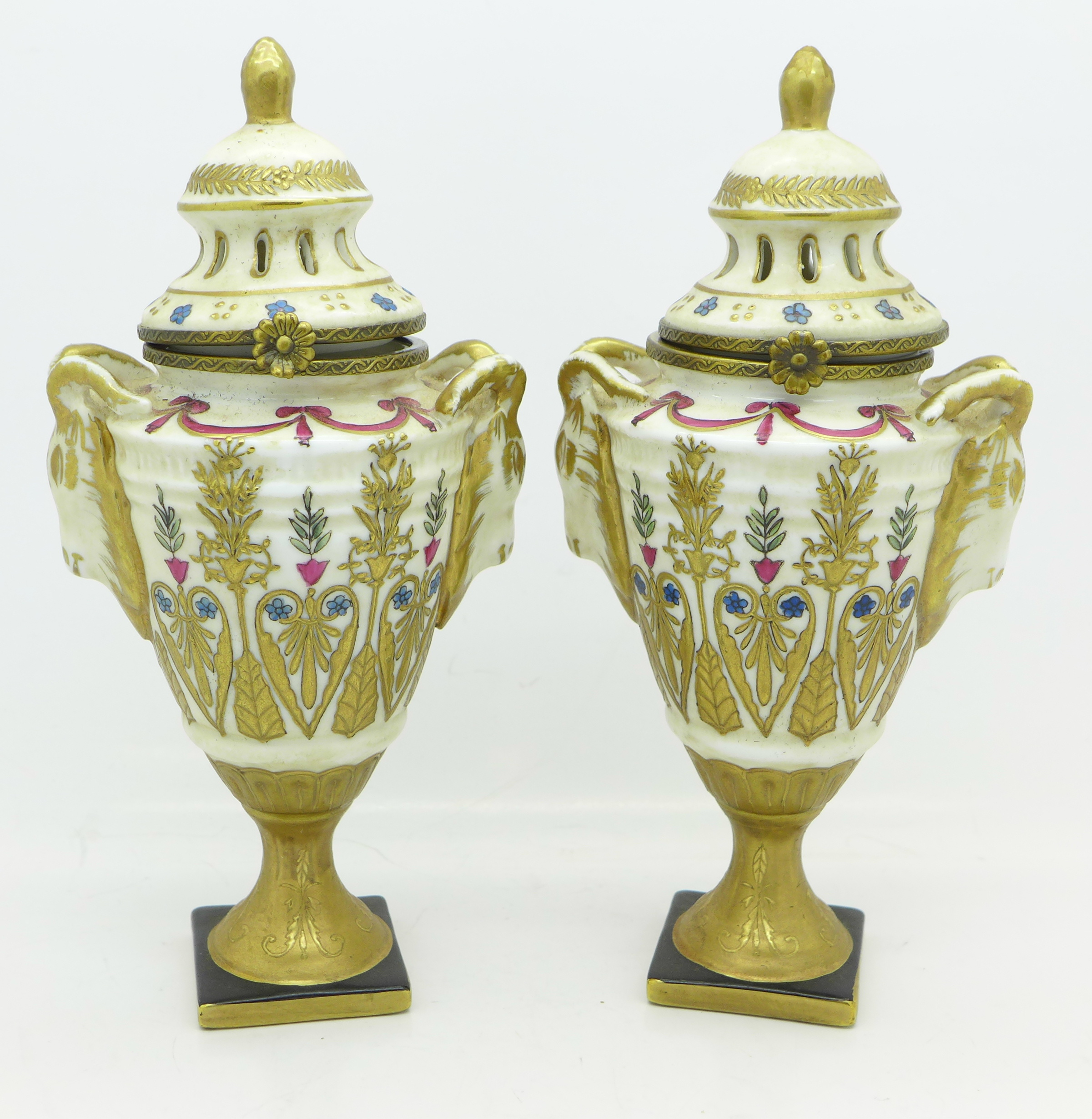 Lot 640D - A pair of continental pot pourri pots with gilt decoration and hinged lids, 17.