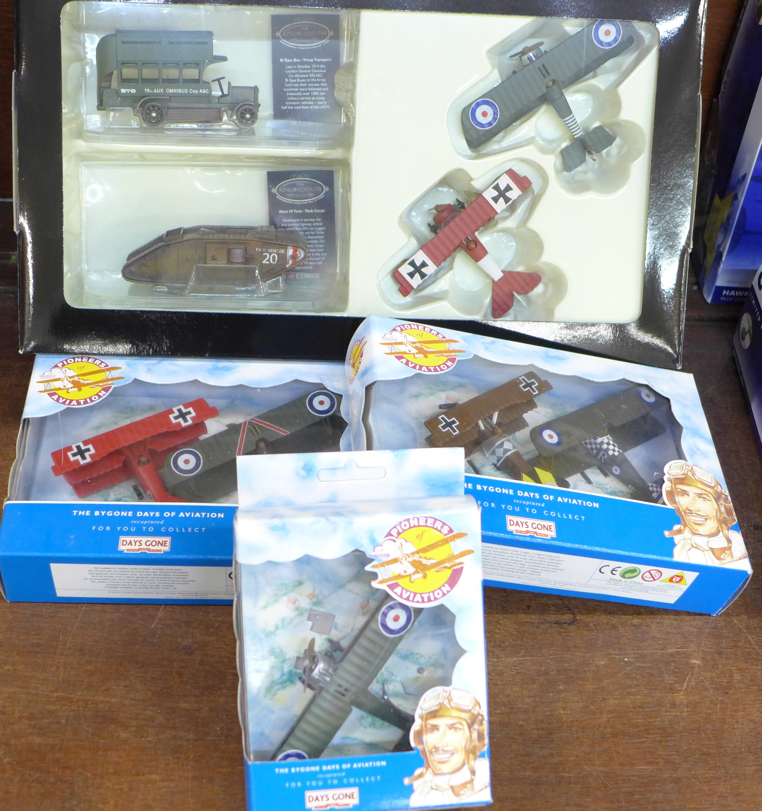 Lot 651 - A Corgi For King and Country die-cast box set and three Days Gone Pioneers of Aviation model planes,