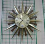 Lot 23 - A Cicero starburst wall clock