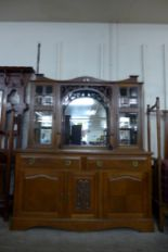 Lot 28 - An Arts and Crafts oak mirrorback sideboard