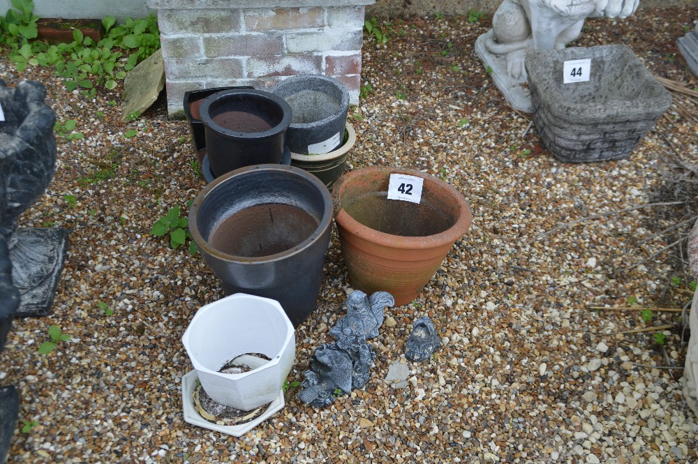 Lot 42 - A collection of plant pots & garden ornaments.