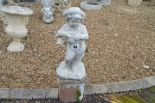 Lot 40 - A pre-cast garden ornament in the form of a child,