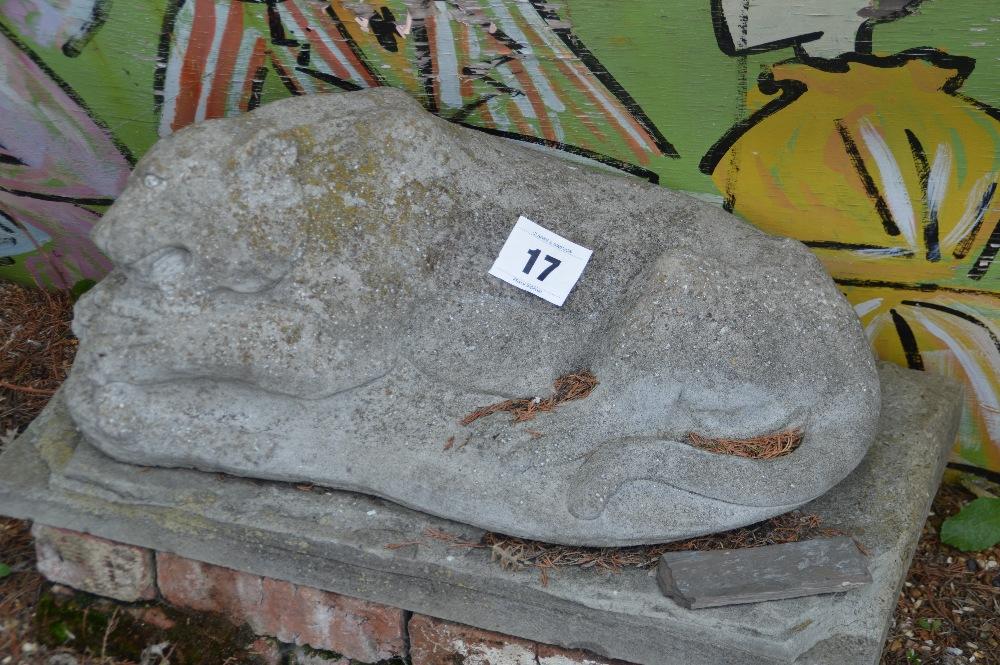 Lot 17 - A stone leopard on stone plinth.
