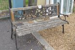 Lot 7 - A timber and cast garden bench, width approx. 126cm,