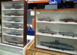 Lot 30 - 2 display cabinets containing plastic kit built modern warships circa 79/80 and 2nd World War