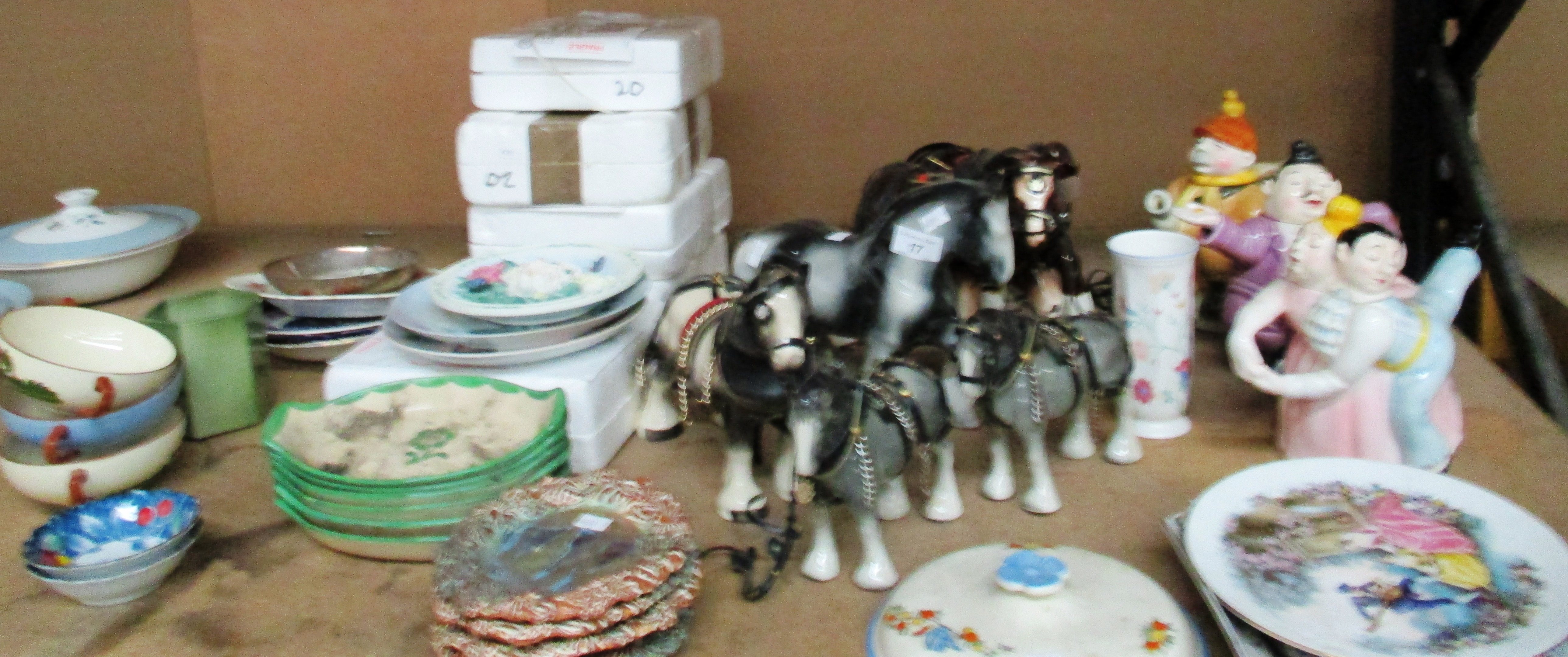 Lot 17 - A collection of novelty teapots, pottery shire horses,