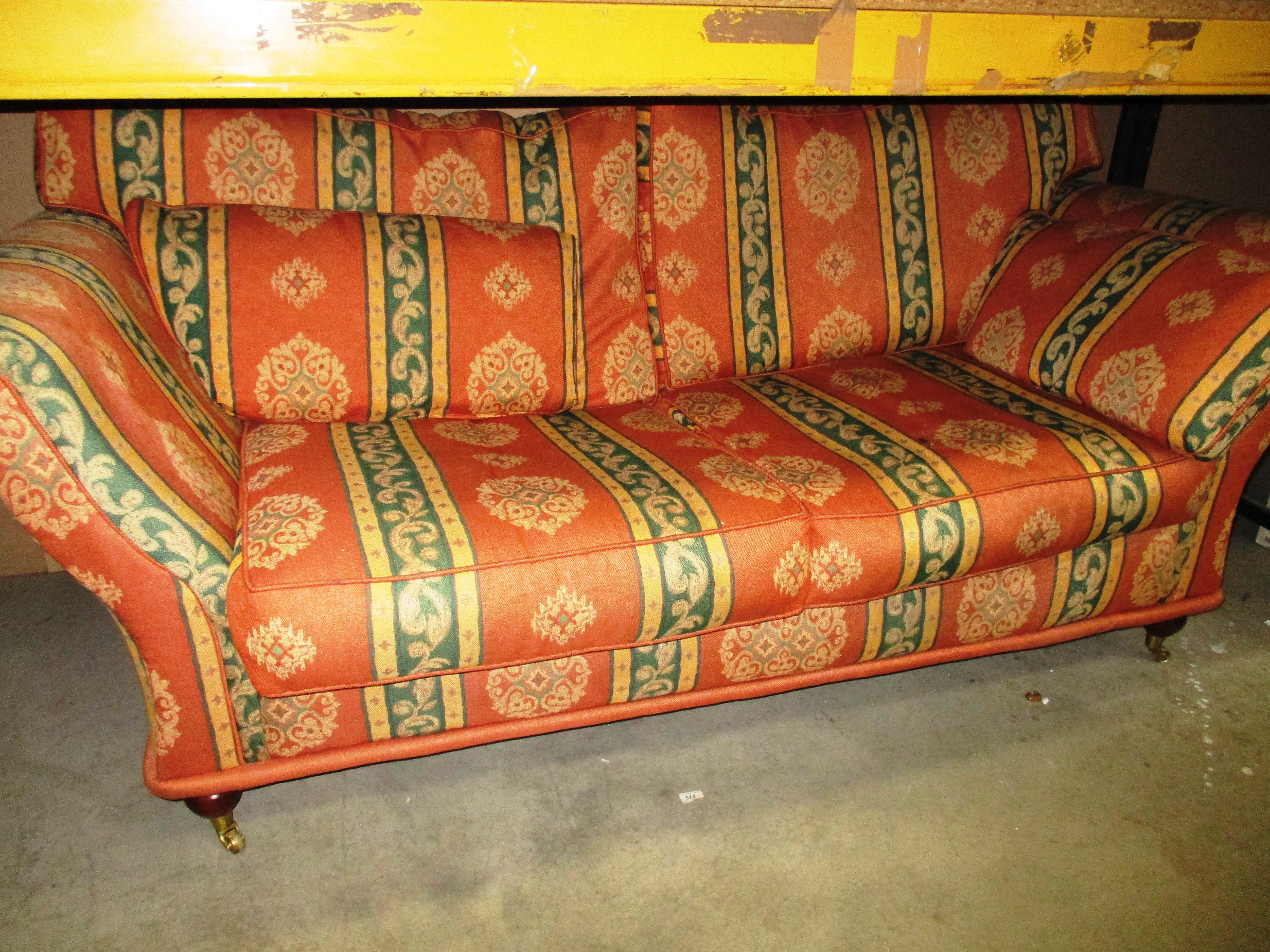 Lot 19 - An orange and green patterned 3 seater sofa