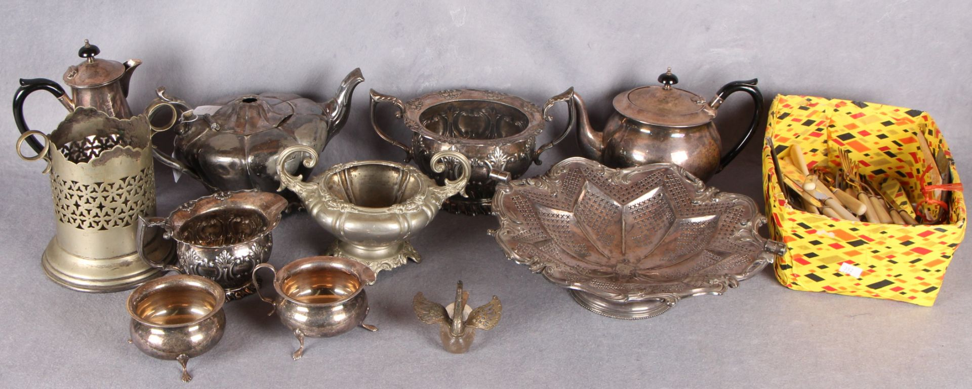Lot 9 - A quantity of plated wares including four piece tea service;