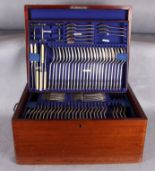 Lot 12 - A suite of plated table cutlery, twelve place settings (some items lacking),