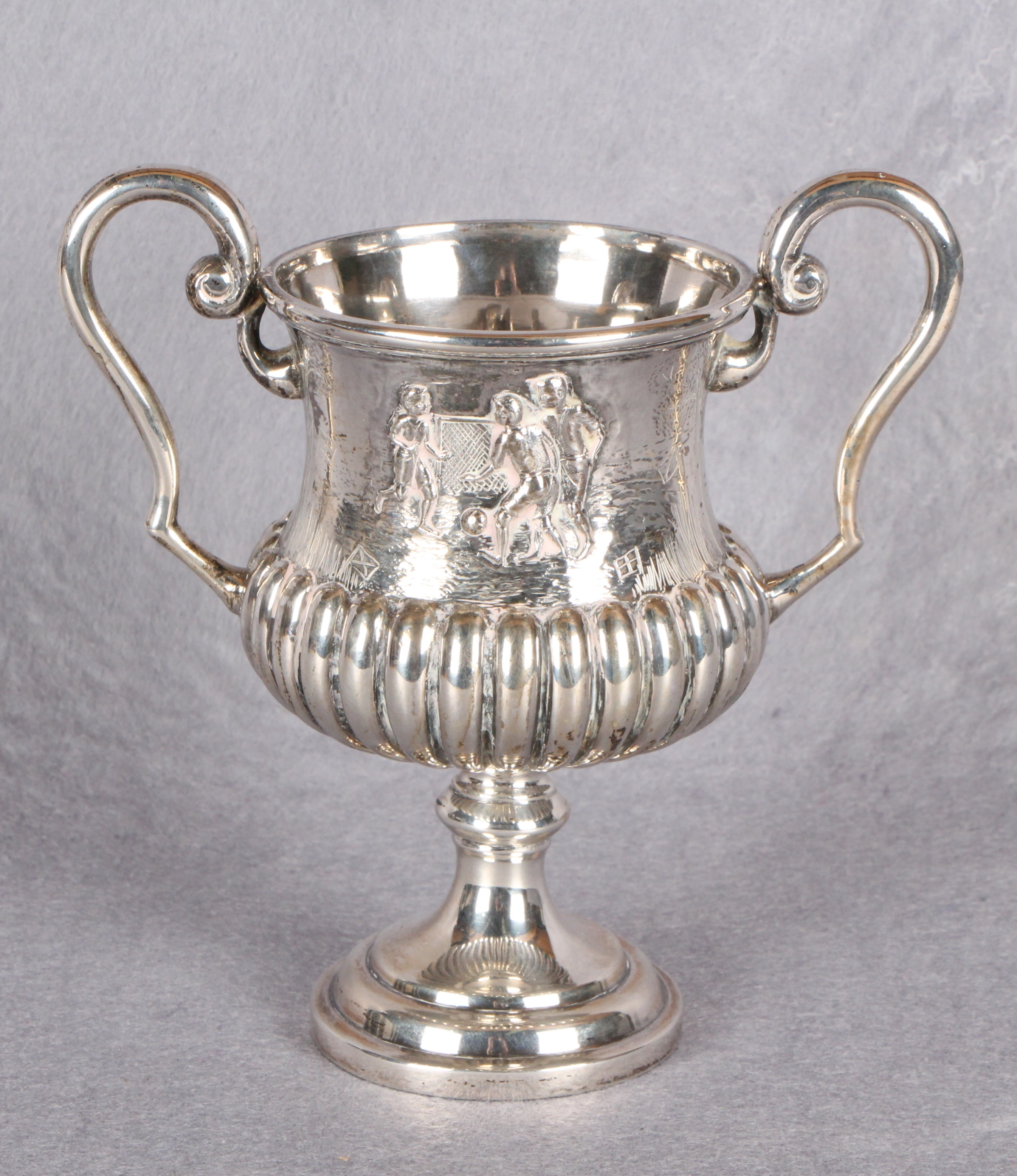 Lot 1 - A Victorian plated, two handled football trophy, of waisted and semi-fluted form,