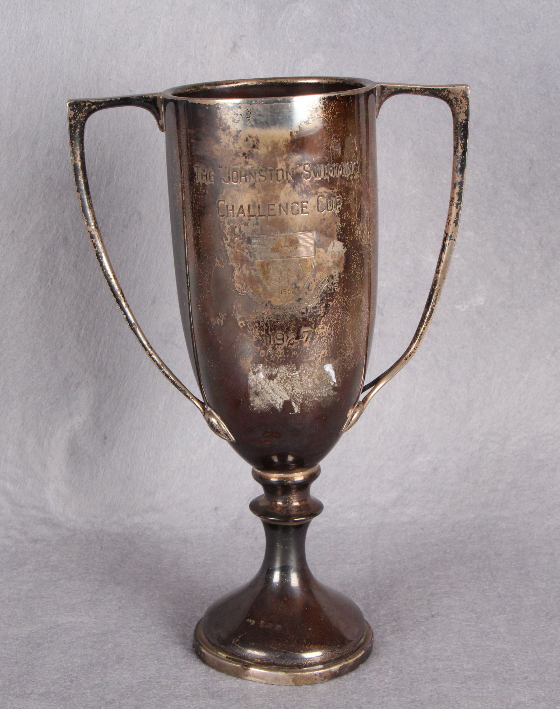 """Lot 31 - A two-handled circular section sports trophy """"The Johnston Swimming Challenge Cup"""","""