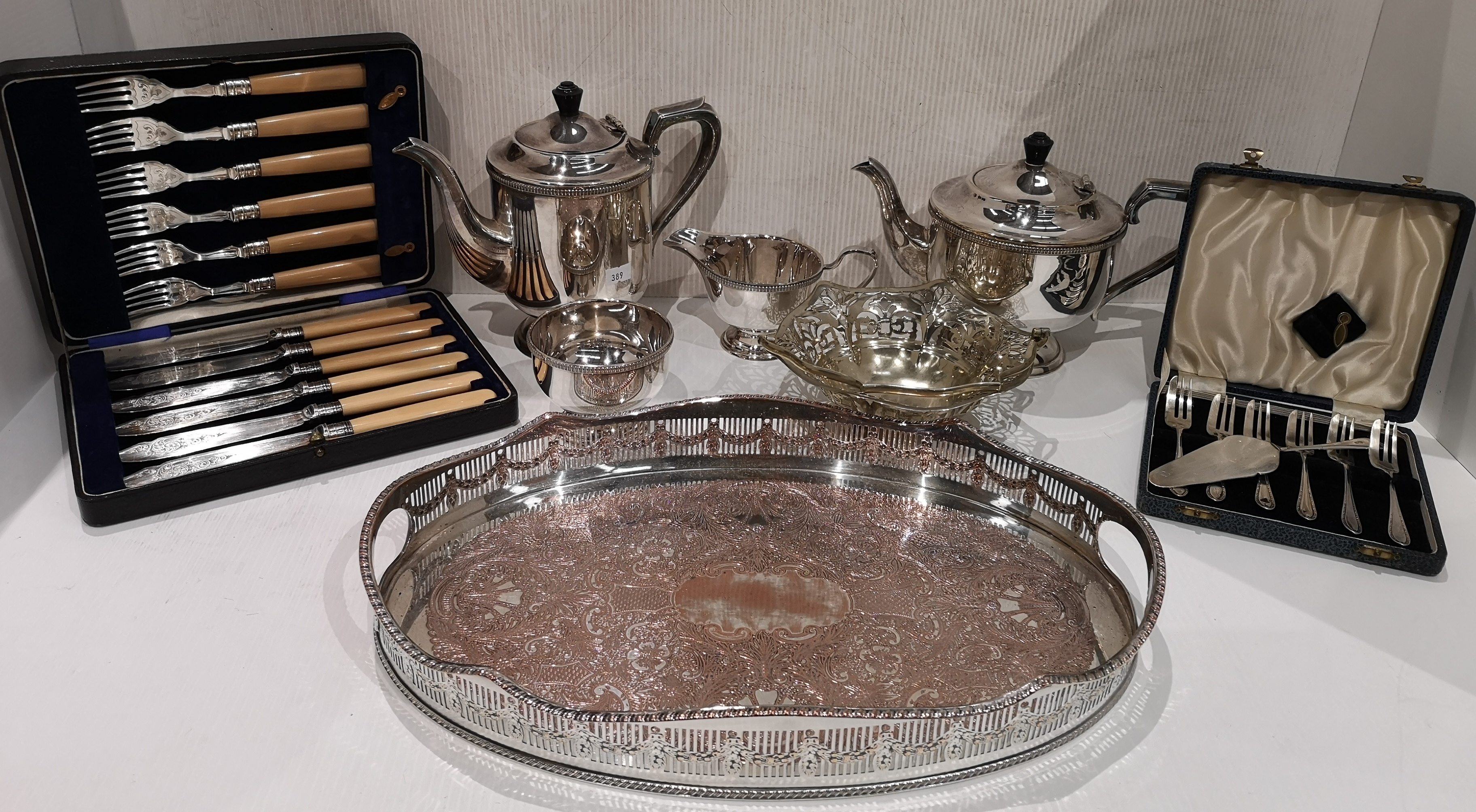 Lot 25 - A plated four piece tea and coffee service, tray,