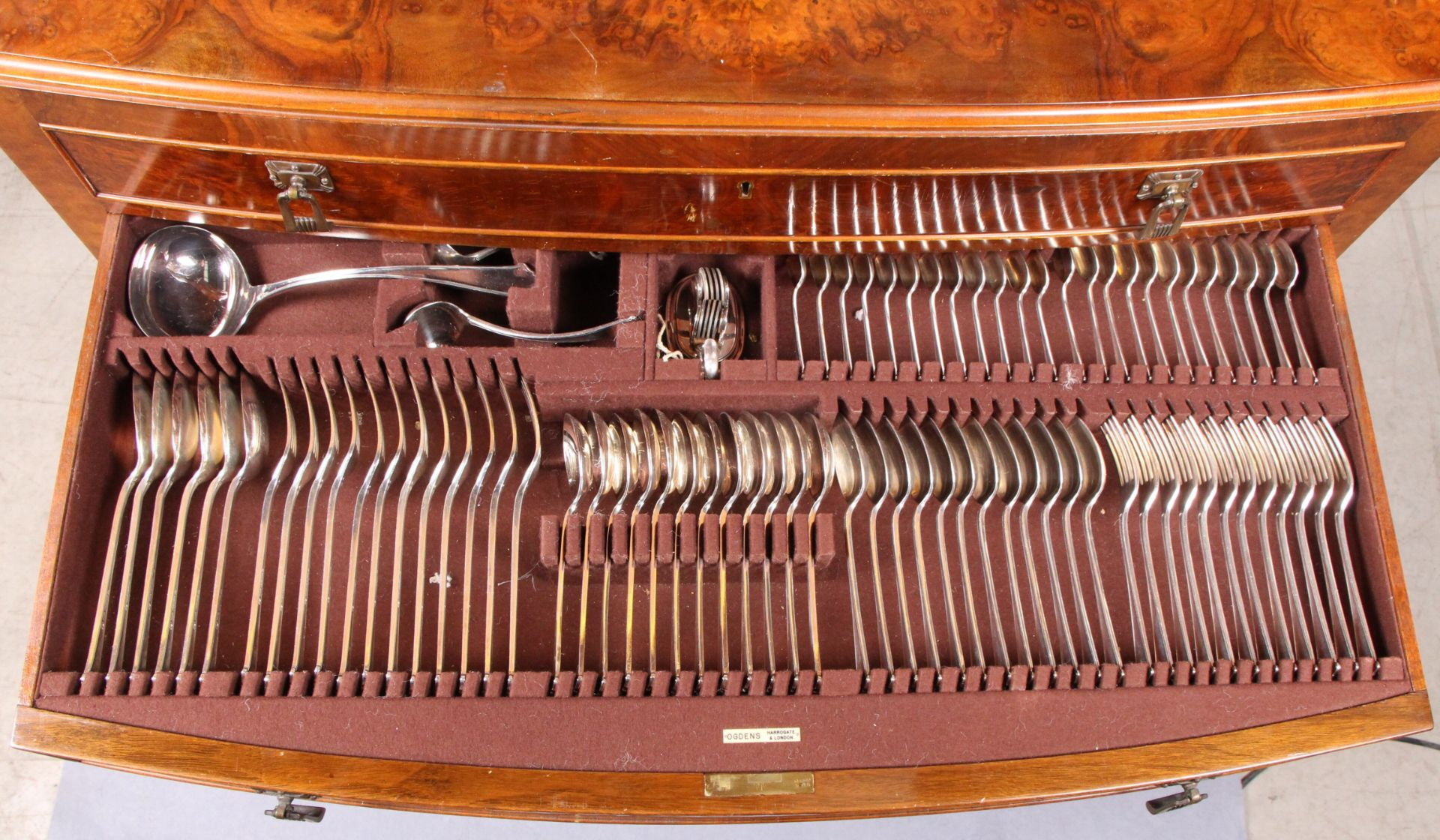 Lot 14 - A comprehensive suite of table cutlery, twelve place settings, in a fitted, figured walnut,