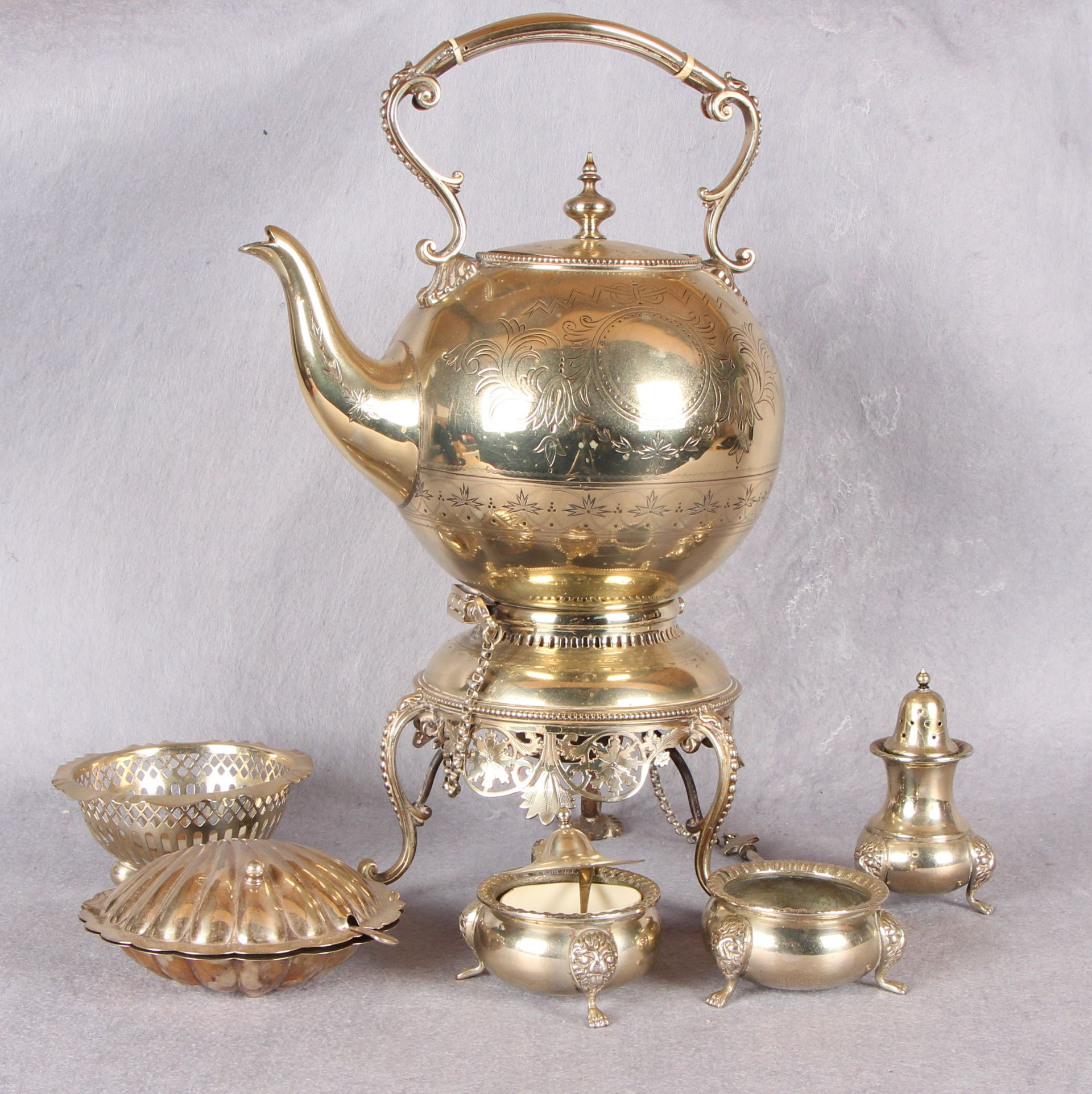 Lot 19 - Plated wares comprising Victorian spirit kettle with stand and burner three piece condiment set,